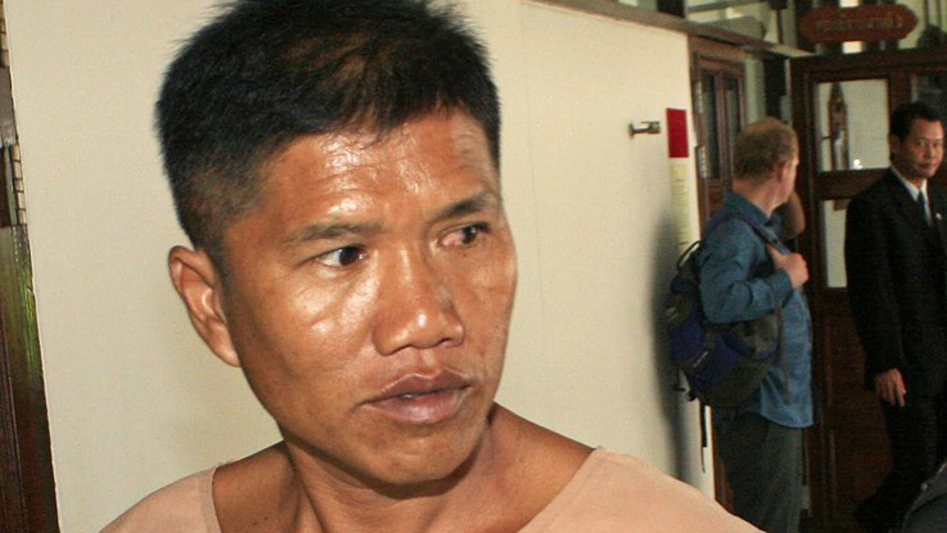 Former policeman Uthai Dechawiwat appears at the Provincial court in Chiang Mai province on August 20, 2013. The court sentenced Dechawiwat to nearly four decades in jail for shooting dead a Canadian tourist in a scuffle in a sleepy northern resort town.