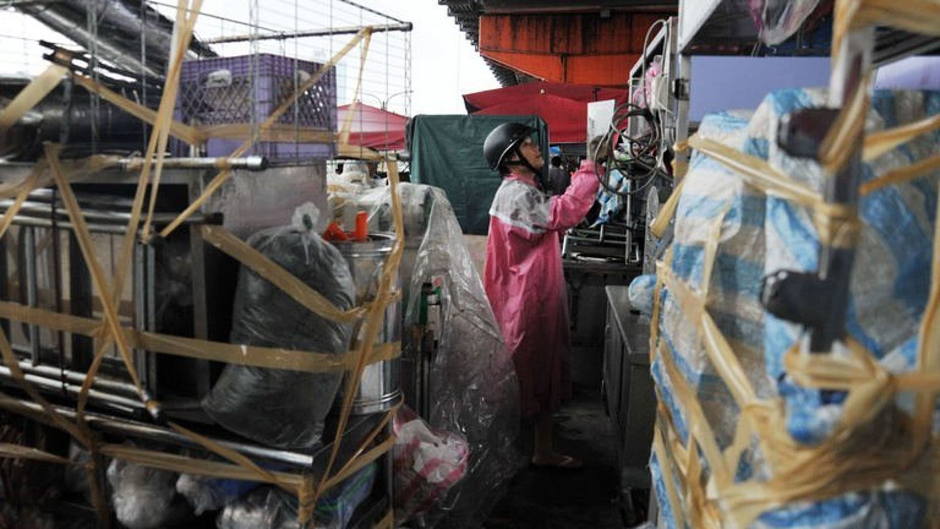 Residents pack up their food stands in preparation for Tropical Storm Trami in Taipei on August 20, 2013. Taiwan evacuated more than 1,000 tourists from an island and deployed troops on August 20 in preparation for the possible arrival of Tropical Storm Trami.