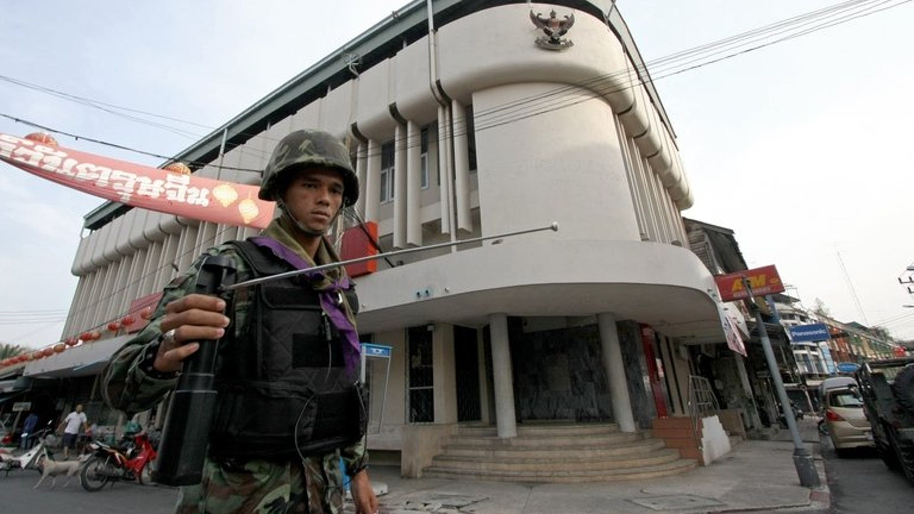 """This picture taken on March 2, 2010 shows a Thai soldier using a GT200 detector as he patrols the streets of Yala, in Thailand's restive south. A British businessman who sold fake bomb detectors worldwide was jailed for seven years on Tuesday, with his judge branding the devices """"useless""""."""