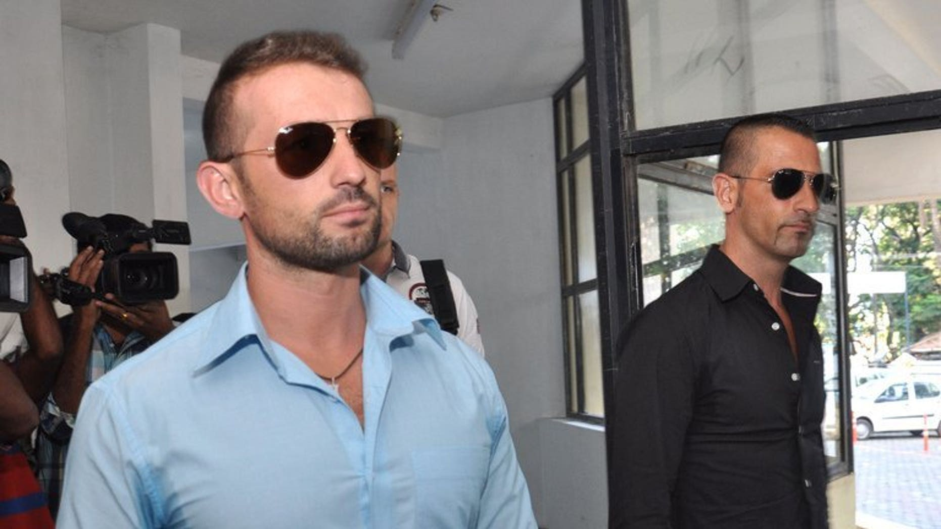 Italian marines Massimiliano Latorre (R) and Salvatore Girone come out from the police commissioners office in Kochi on December 20, 2012. Four Italian marines summoned to give evidence in the trial of Latore and Girone over the shooting deaths of two Indian fishermen have refused to travel to the country, a report said Tuesday.