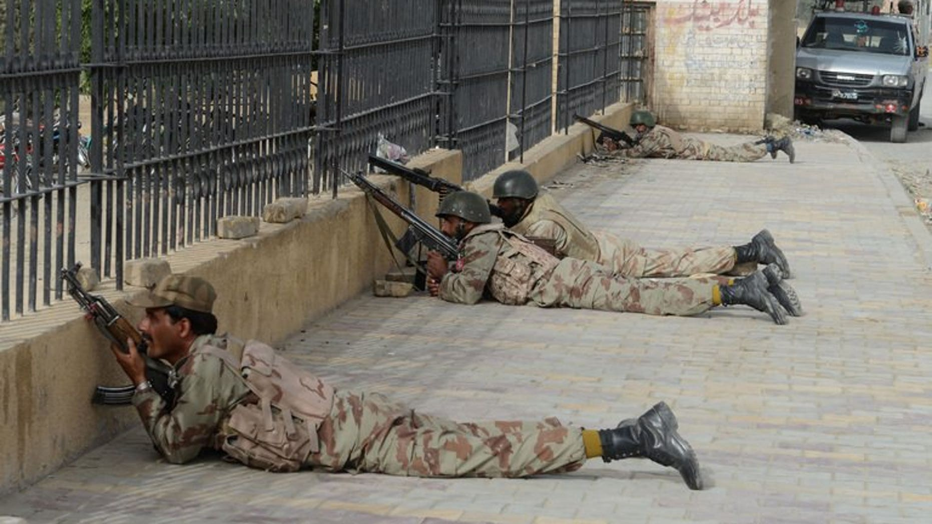 Pakistani paramilitary soldiers take position in Quetta, the capital of Baluchistan province, on June 15, 2013. Paramilitary forces Tuesday seized more than 100 tonnes of bomb-making chemicals from a truck and a compound in southwest Pakistan and detained 10 suspects, officials said.