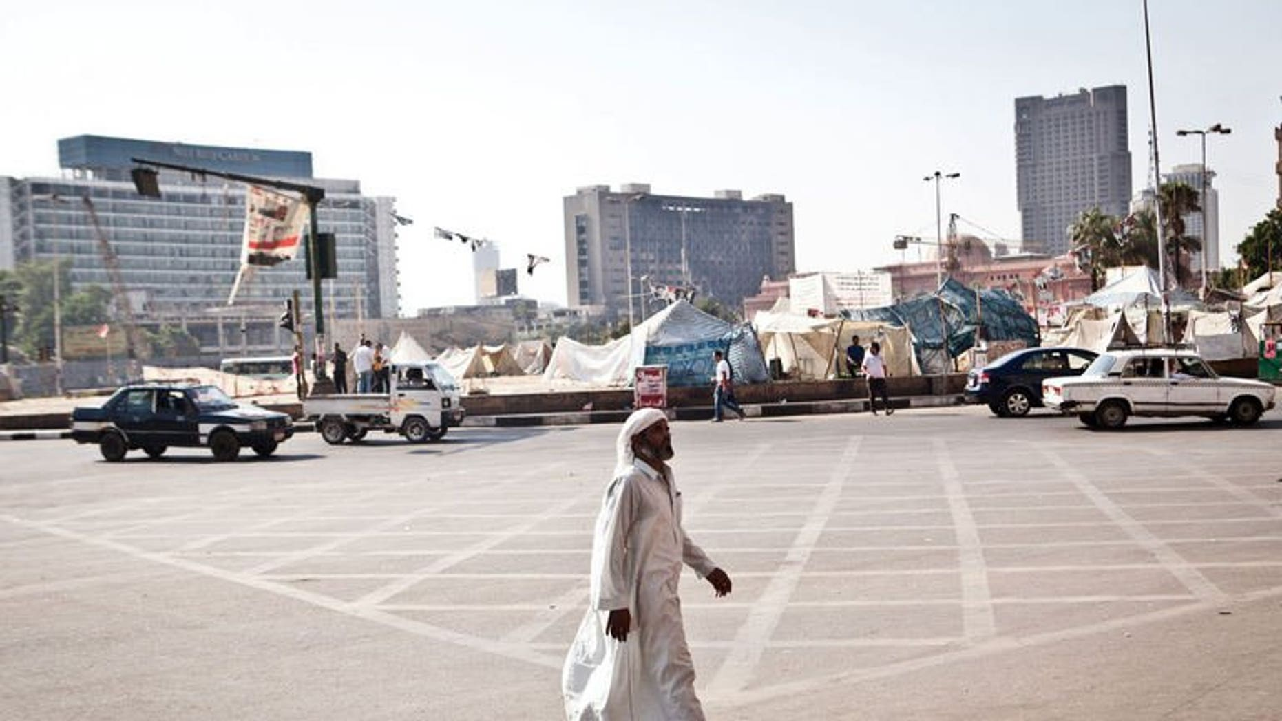 An Egyptian man walks in Tahrir Square, after it has been partially reopened to traffic, on August 20, 2013 in Cairo. European Union foreign policy chief Catherine Ashton said Tuesday that she had offered to return to Cairo to help facilitate a way out of the country's crisis.