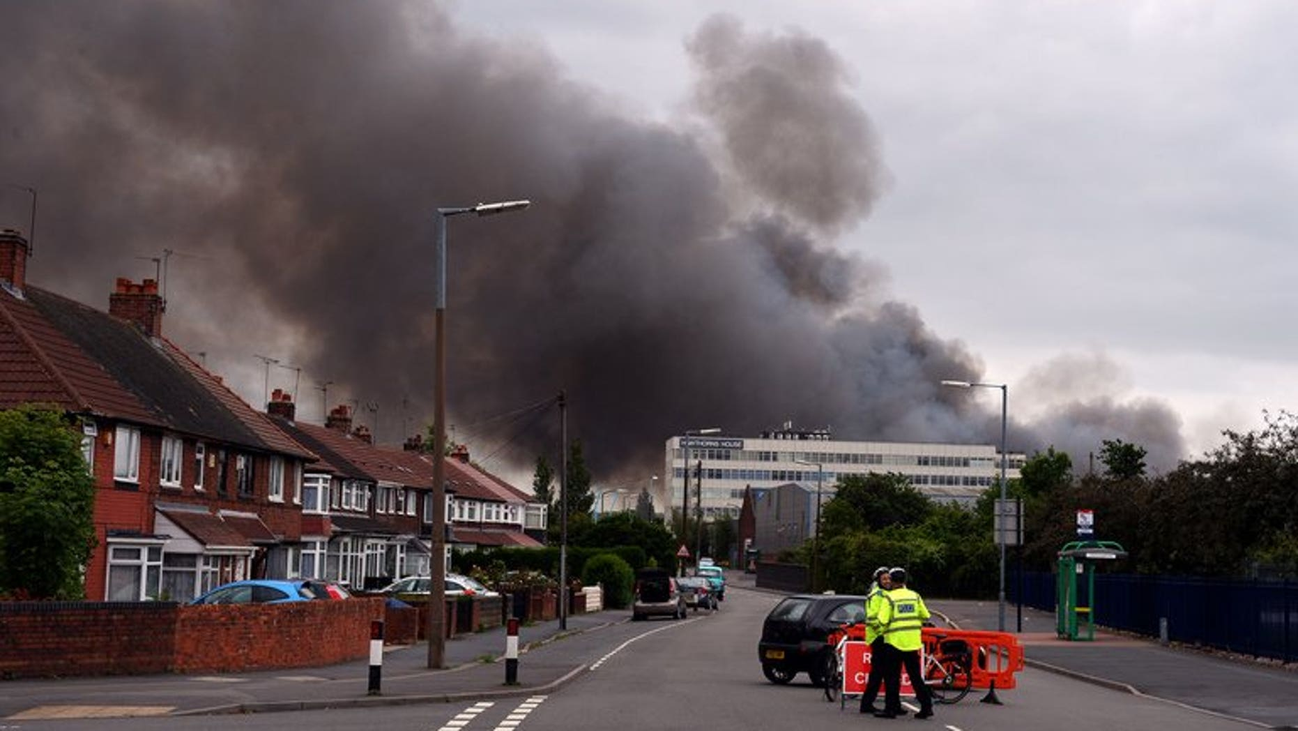 File picture of a fire at a recycling centre in Smethwick, Birmingham, on July 1. Around 50 firefighters were on Wednesday battling a huge fire at a recycling plant near Manchester, the fire service said.