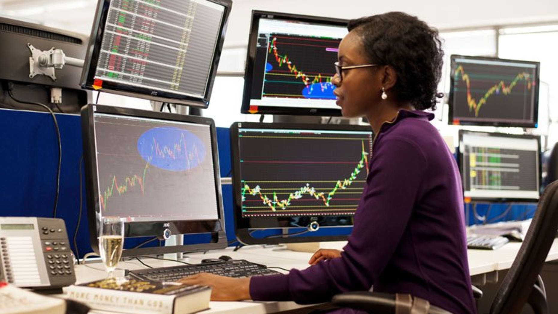 A woman takes part in a trader training programme in London. London shares opened lower on Wednesday on a technical adjustment as more shares went ex-dividend.