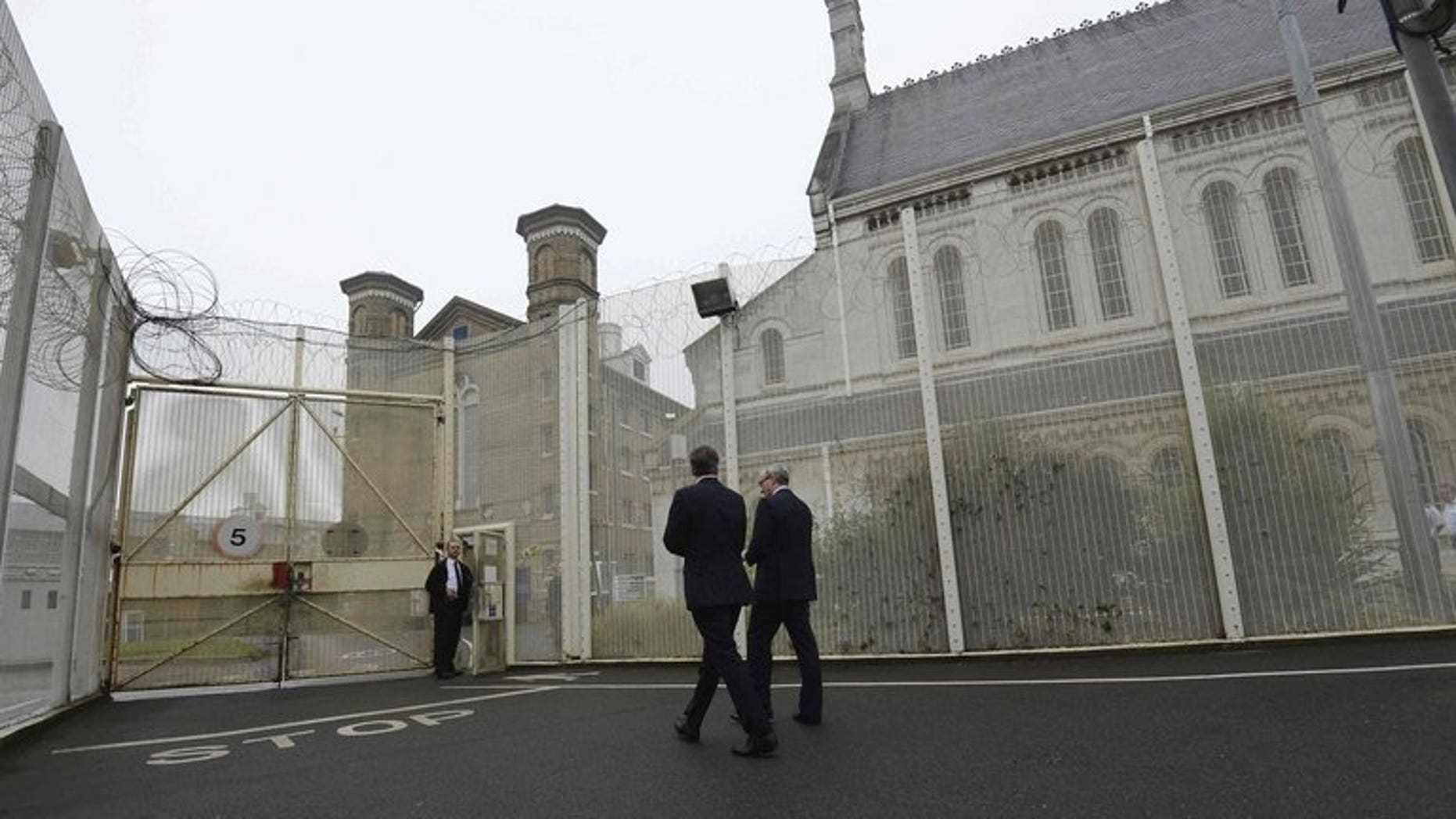 """Prime Minister David Cameron visits Wormwood Scrubs Prison in west London last October. A triple murderer is appealing to the European Court of Human Rights to challenge his """"life means life"""" sentence, the first Briton to do so."""