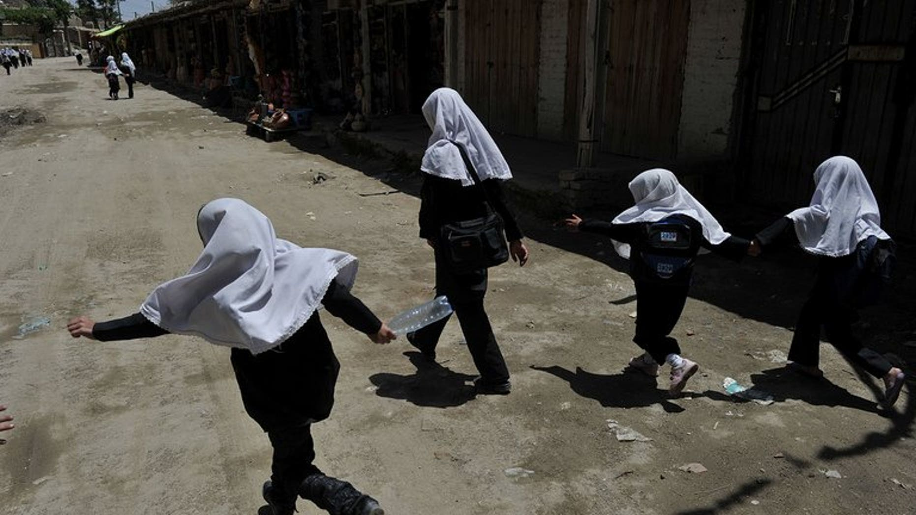 Afghan schoolgirls in Istalif, north of Kabul, on May 29, 2012. The education chief of an Indonesian city sparked outrage Wednesday after proposing that teenage schoolgirls should undergo virginity tests to enter senior high school.