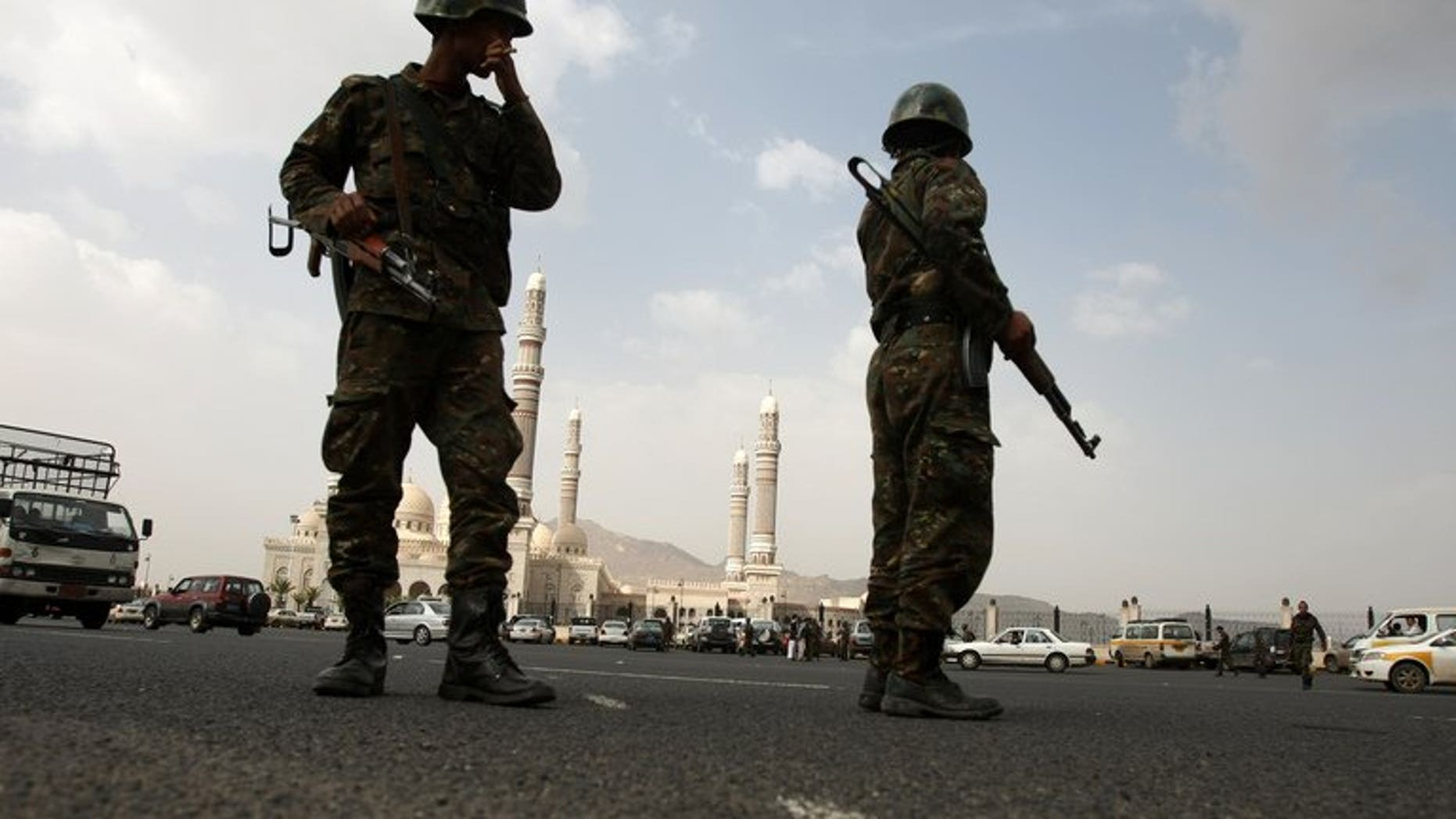 Yemeni soldiers stand guard outside the al-Saleh mosque on August 5, 2012, in Sanaa. The intelligence chief for the southern Yemeni city of Aden and his son were gunned down in their car Wednesday in a suspected Al-Qaeda hit, a security source said.