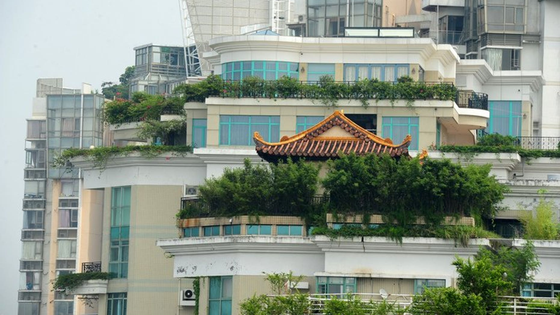 A temple is seen on the rooftop of a 21-storey apartment building in Shenzhen, south China's Guangdong province on August 21, 2013. The latest rooftop architectural wonder highlighted in China is a temple that brings worshippers closer to the heavens by being on top of a 21-storey apartment block.