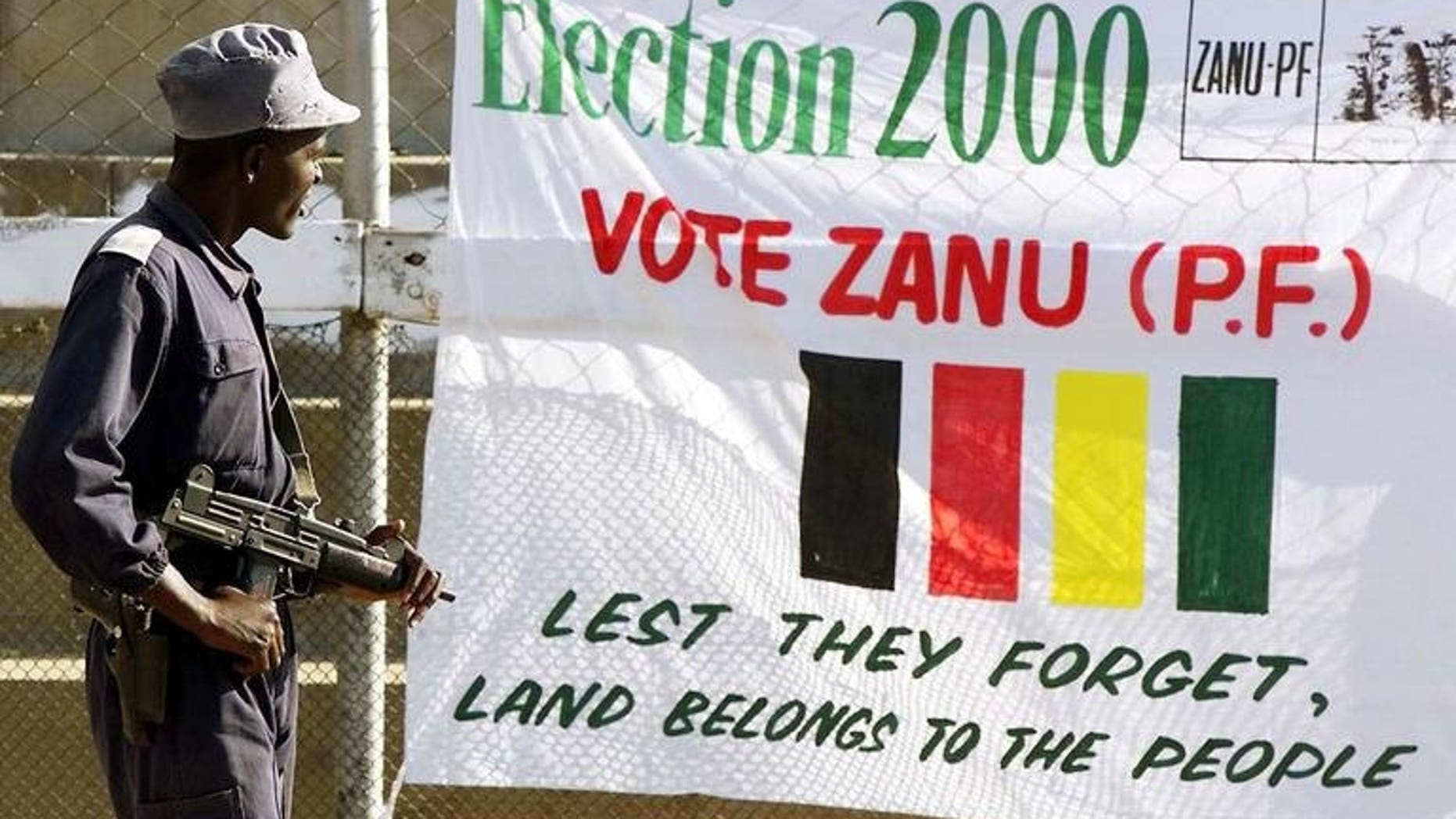 A ZANU-PF poster at a rally in Mutare in 2000. Zimbabwean politician Enos Nkala, who co-founded Robert Mugabe's ZANU party and was defence minister during a massacre of some 20,000 ethnic Ndebele, died Wednesday, a party official said.