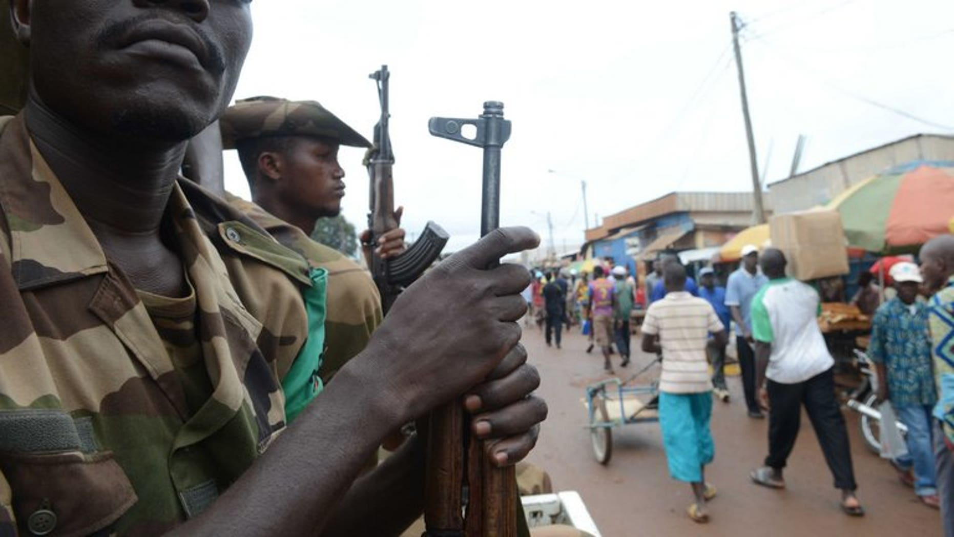 Members of the Multinational Force of Central Africa patrol on July 20 in Bangui. Armed clashes erupted in Bangui as the new president's forces tried to disarm supporters of former leader Francois Bozize, a military source said on Wednesday.