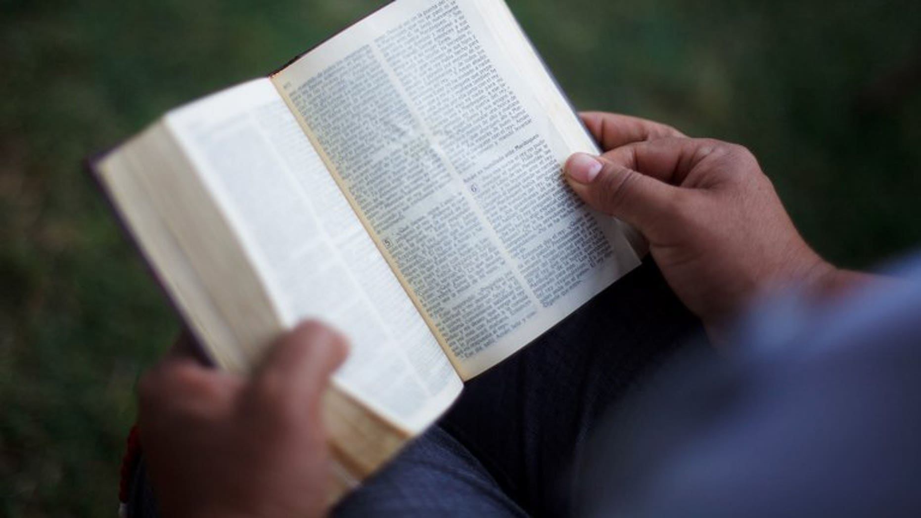A person reads the Bible on April 25, 2012 in Phoenix, Arizona. An Iranian Christian convert has been sentenced to 10 years in prison for distributing Bibles in his home country, the Vatican missionary news agency Fides reported on Wednesday.