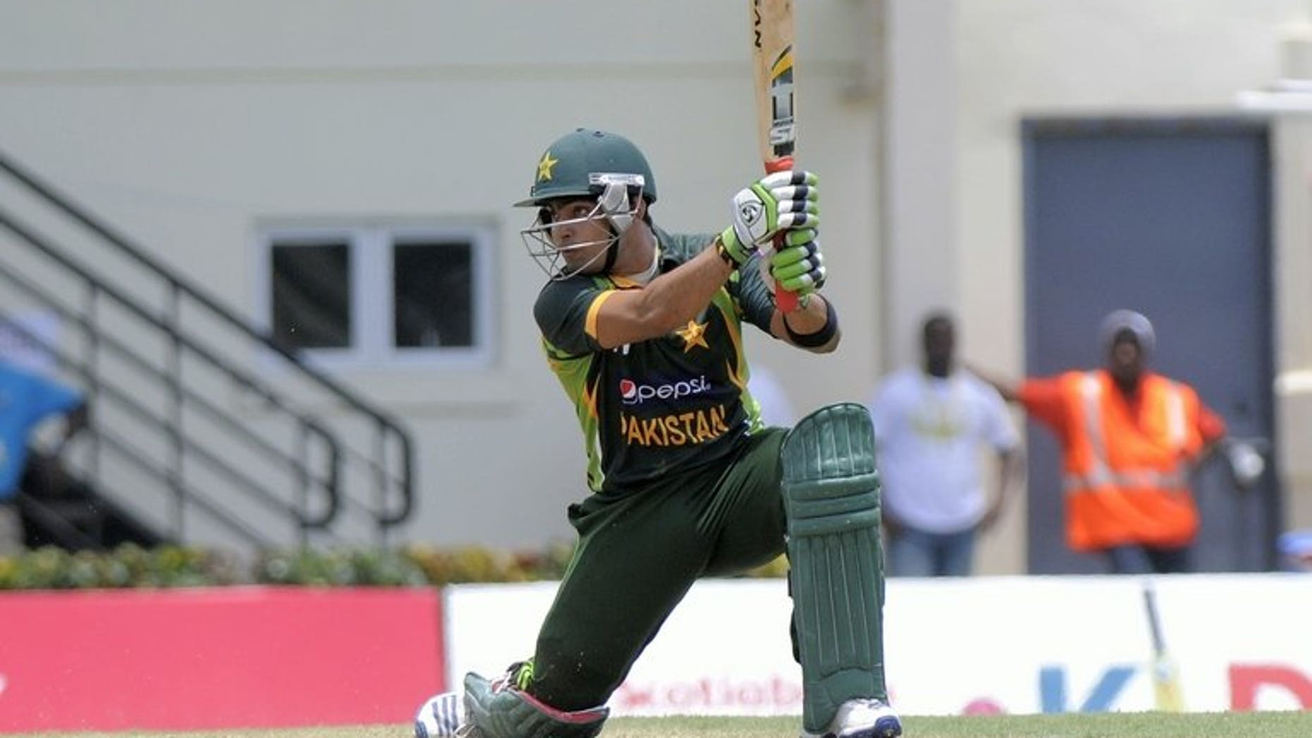 Pakistan batsman Umar Akmal in action at Beausejour Cricket Ground in Gros Islet on July 19, 2013. Pakistan's talented young batsman Akmal will see a neurologist for further testing after suffering a suspected seizure which forced his withdrawal from the Zimbabwe tour, an official said Wednesday.