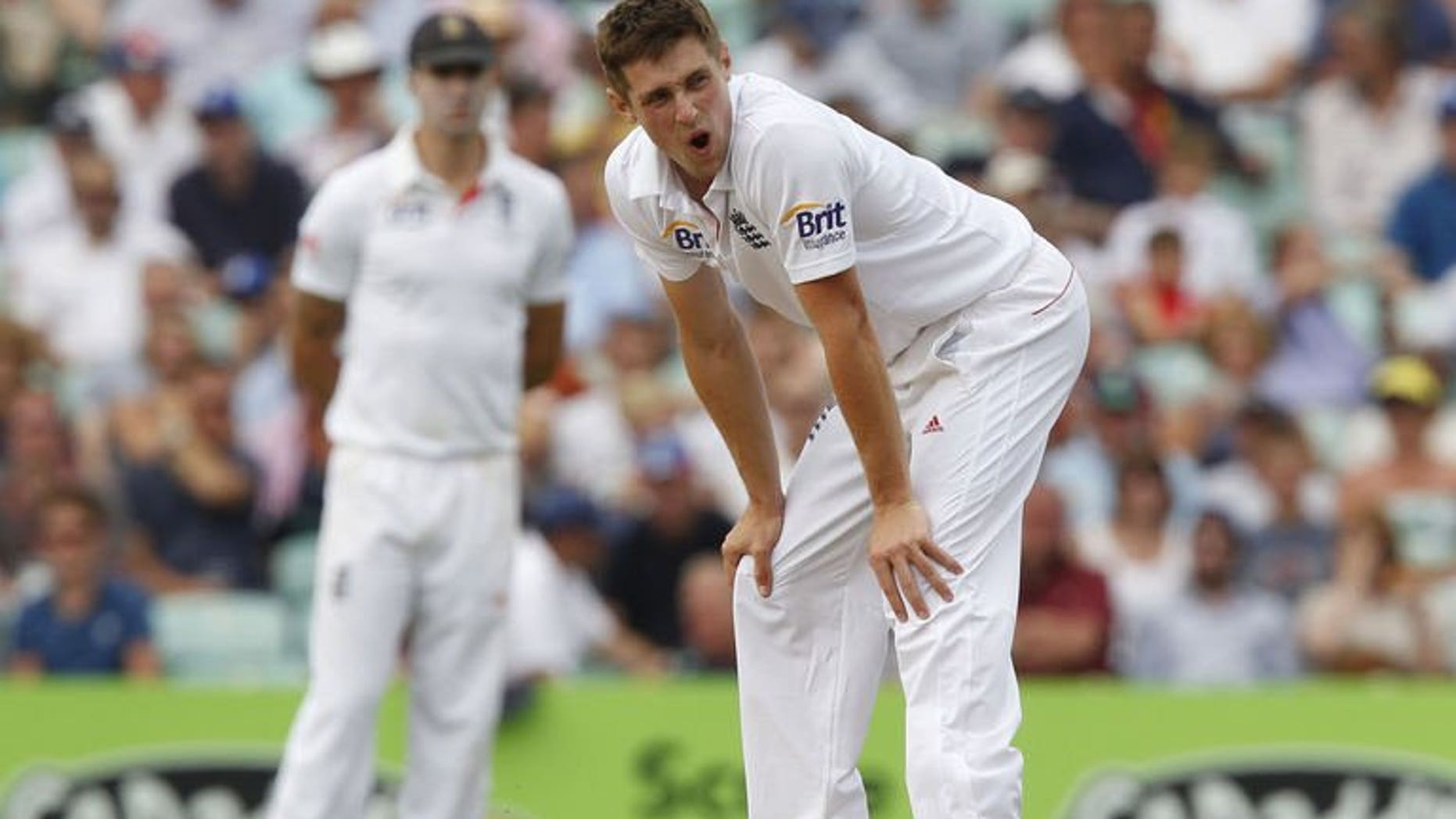 England's Chris Woakes reacts during play on the first day of the fifth Ashes cricket test match between England and Australia at The Oval cricket ground in London on August 21, 2013.