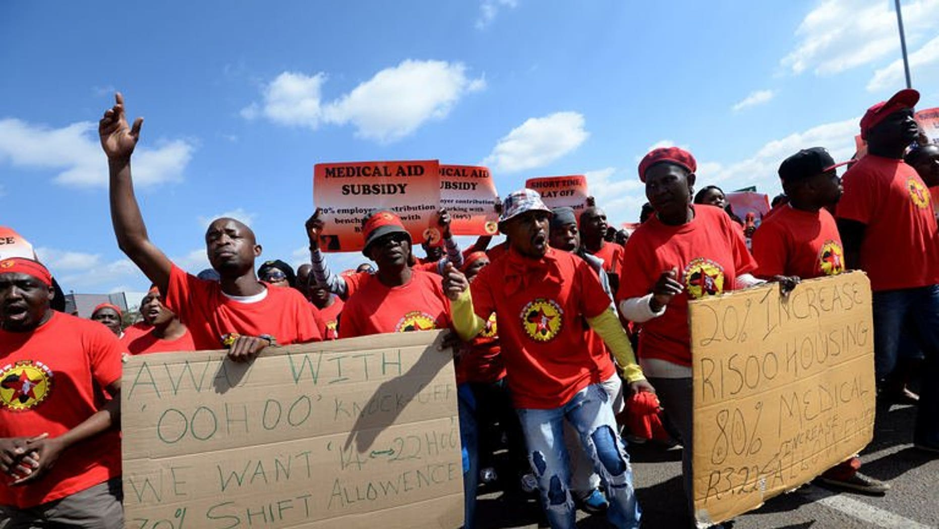 Workers on strike hold signs as they take part in a demonstration outside Ford's plant in Pretoria on August 20, 2013. South African 12-month consumer price inflation jumped to 6.3 percent in July from 5.5 percent in June due to higher fuel prices, official figures showed on Wednesday.