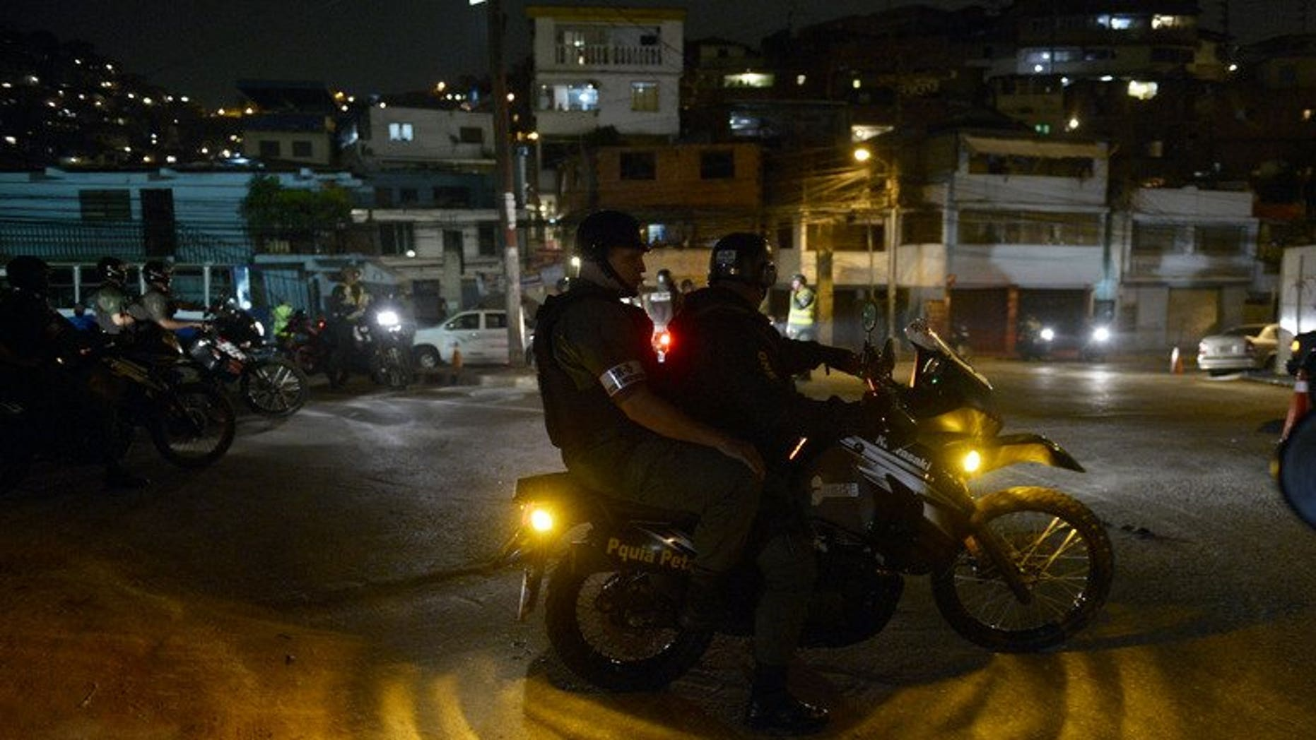 Members of the National Guard carry out a security operation in the impoverished Petare neighbourhood, one of Caracas' most dangerous slums, on May 13, 2013. Venezuela is installing 30,000 surveillance cameras to crack down on rampant crime, officials said Wednesday.