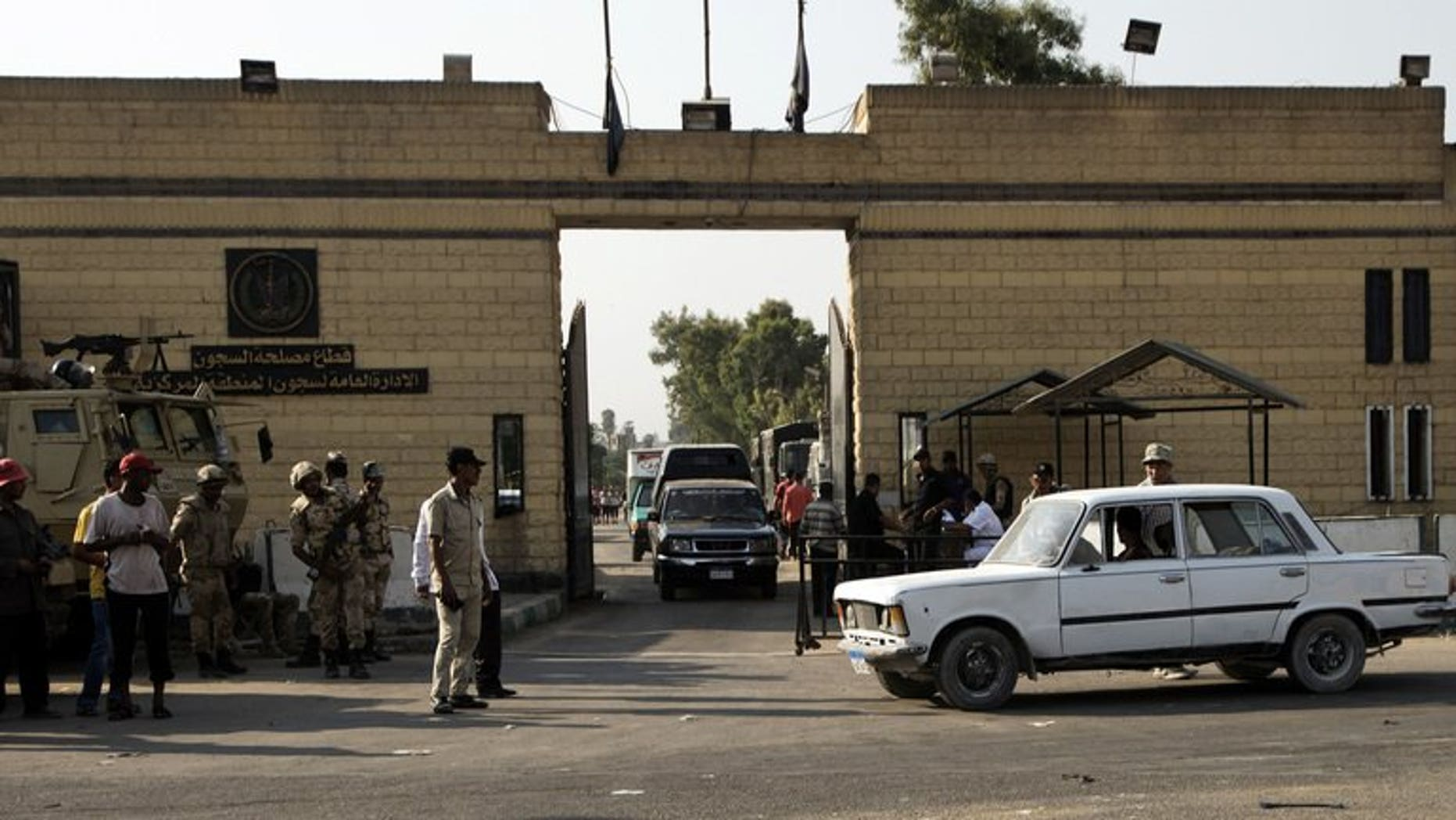 Egyptian security forces stand guard outside one of the gate of the Tora prison where former Egyptian president Hosni Mubarak is detained on August 21, 2013 in Cairo. Egyptians awaited Thursday the possible release of Mubarak after a court ordered he be freed pending his re-trial on charges of complicity in the deaths of protesters, and other crimes.
