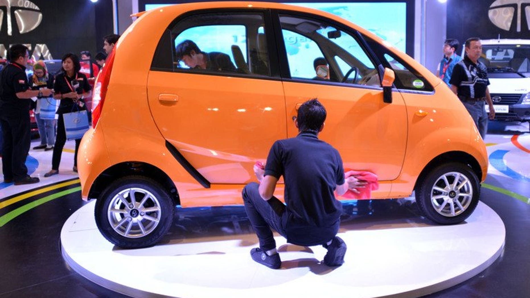 "A Nano car manufactured by Tata of India is displayed at the Indonesia International Motor Show 2012 in Jakarta. India's top vehicle maker Tata Motors says it plans to reposition the Nano as a ""smart city car"" after its marketing pitch as the world's cheapest auto resulted in disappointing sales."
