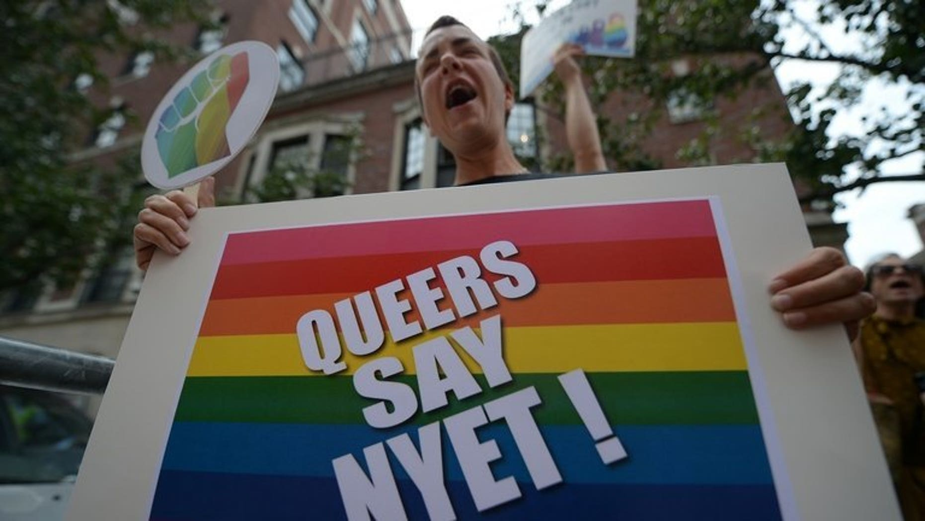 Protesters demonstrate against Russian anti-gay legislation in front of the Russian Consulate in New York on July 31, 2013. Russian government-funded TV channel RT was at the centre of a new controversy Thursday after taking an American journalist off air for launching into a diatribe against Russia's anti-gay legislation.