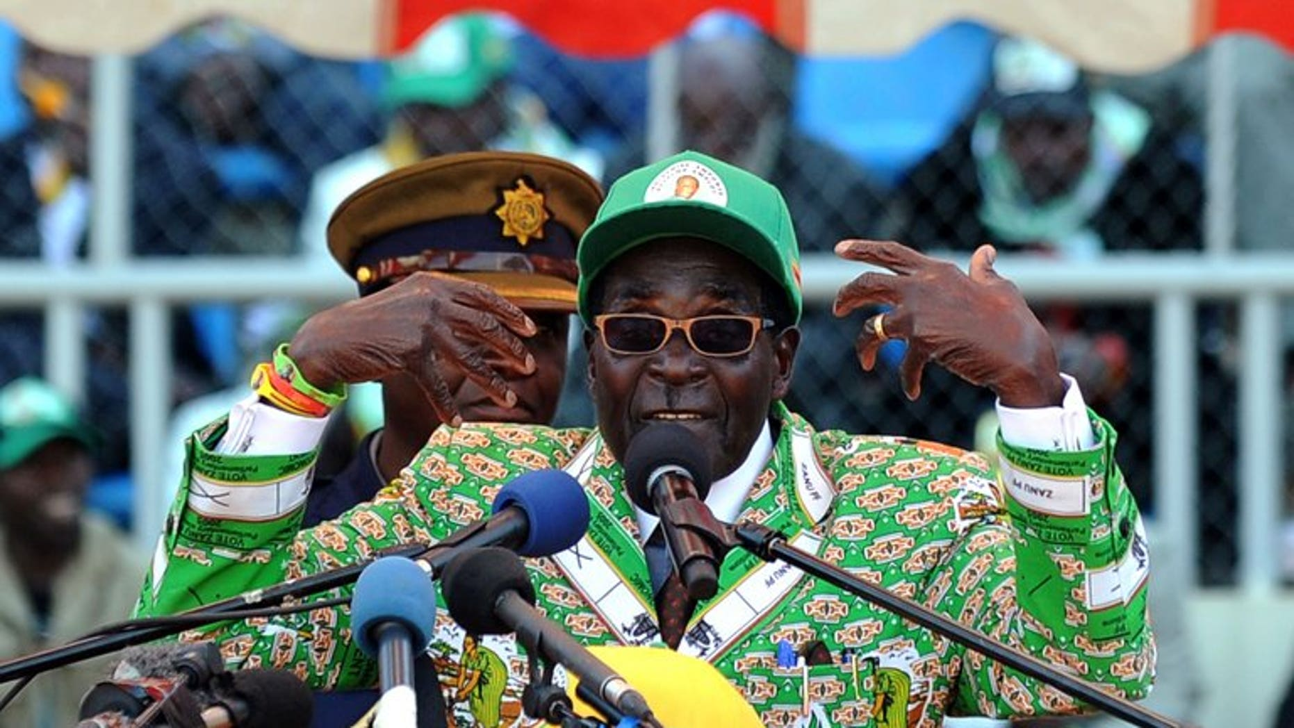 """Zimbabwe's President Robert Mugabe addresses at a rally in Harare on July 28, 2013. Veteran leader Robert Mugabe was sworn in as Zimbabwe's president for another five-year term before a stadium packed with thousands of jubilant supporters Thursday. Mugabe, 89, pledged """"to observe, uphold and defend the constitution of Zimbabwe"""" in an oath administered by Chief Justice Godfrey Chidyausiku."""