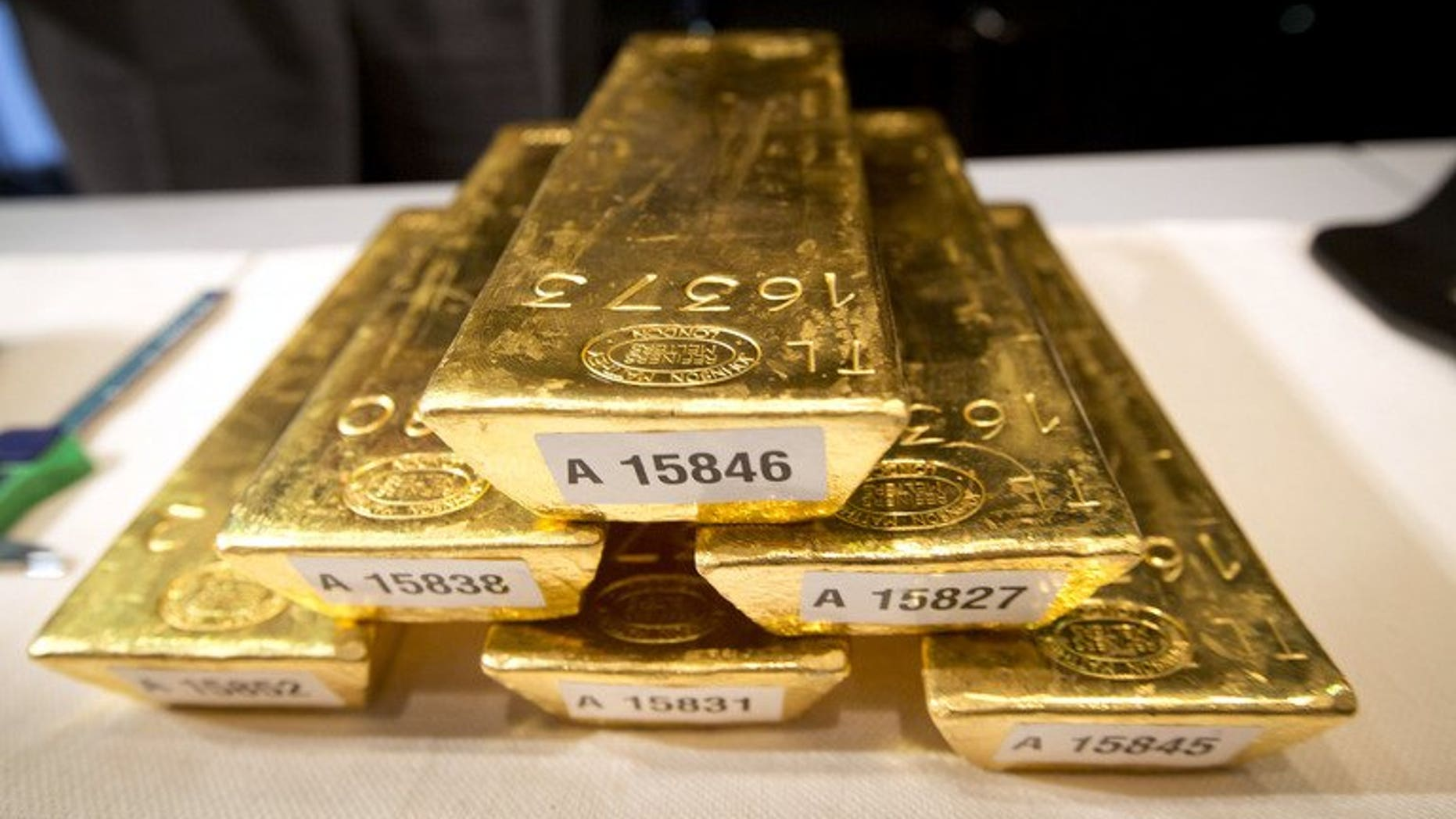 Bars of gold at a press conference at the German Federal Bank in Frankfurt, Germany, on January 16. The world's biggest gold producer, the Canadian firm Barrick Gold, is to sell three mines in Australia to South African competitor Gold Fields for $300 million, the companies said.