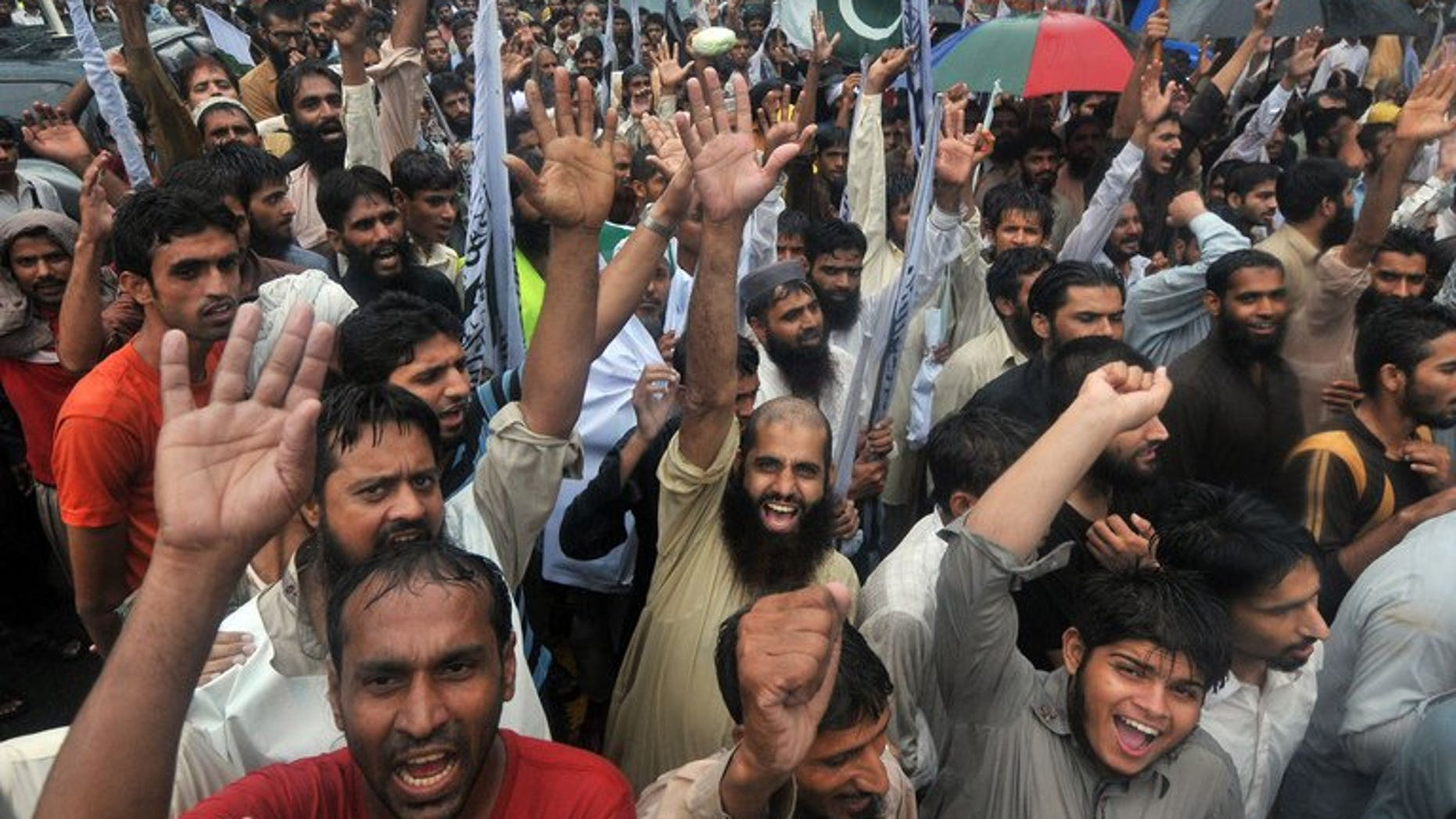 Supporters of Pakistan's outlawed Islamic hardline group Jamaat ud Dawa shout slogans during an anti-Indian protest rally in Lahore on August 14, 2013. Pakistan accused Indian troops Thursday of killing a soldier in disputed Kashmir, the latest in a series of reported clashes which have raised tensions between the nuclear-armed neighbours.