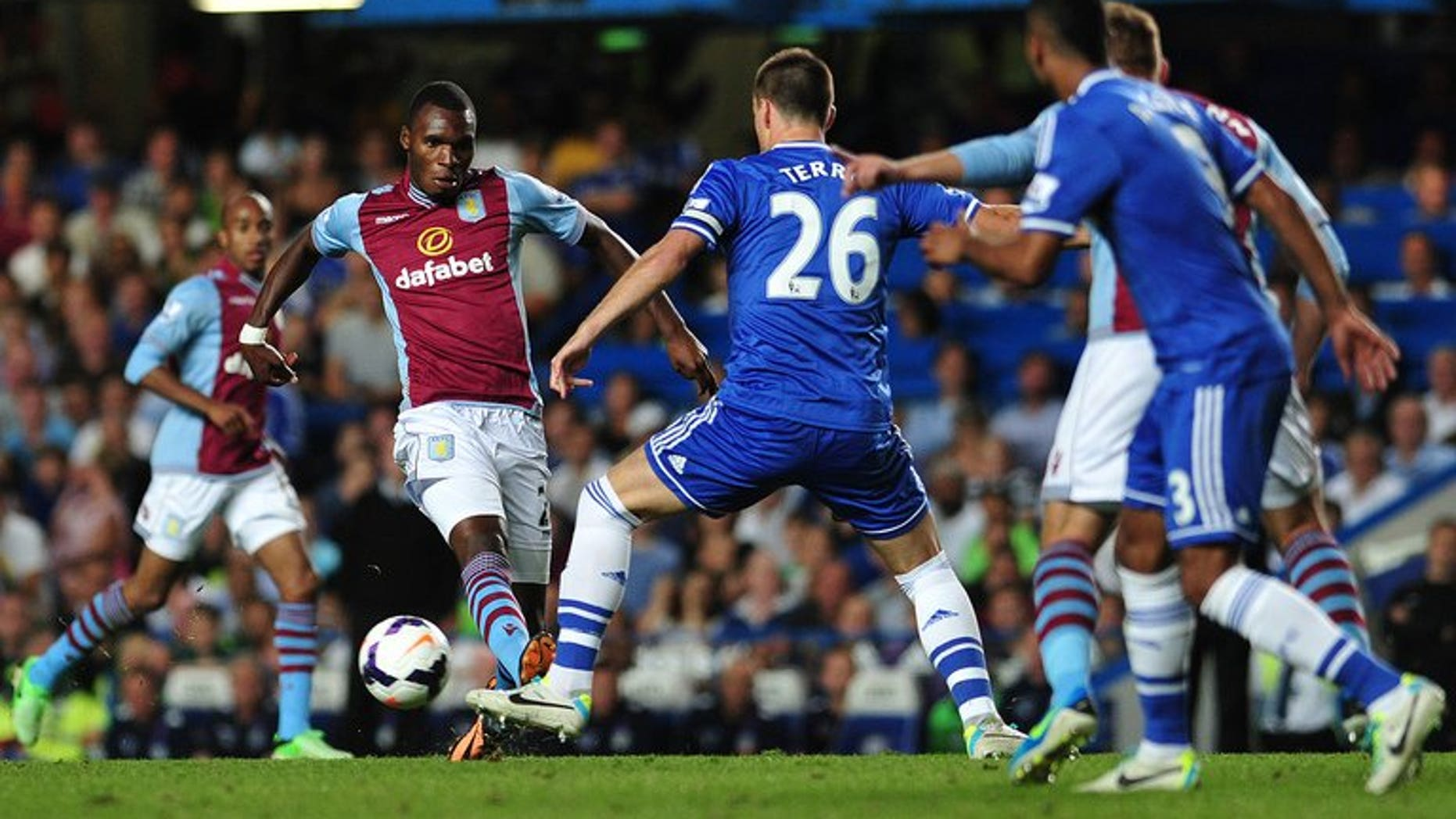 John Terry (centre) tackles Aston Villa's Christian Benteke at Stamford Bridge on Wednesday. Aston Villa manager Paul Lambert on Thursday claimed that his side were the victims of double standards after being denied a late penalty in their Premier League defeat at Chelsea.