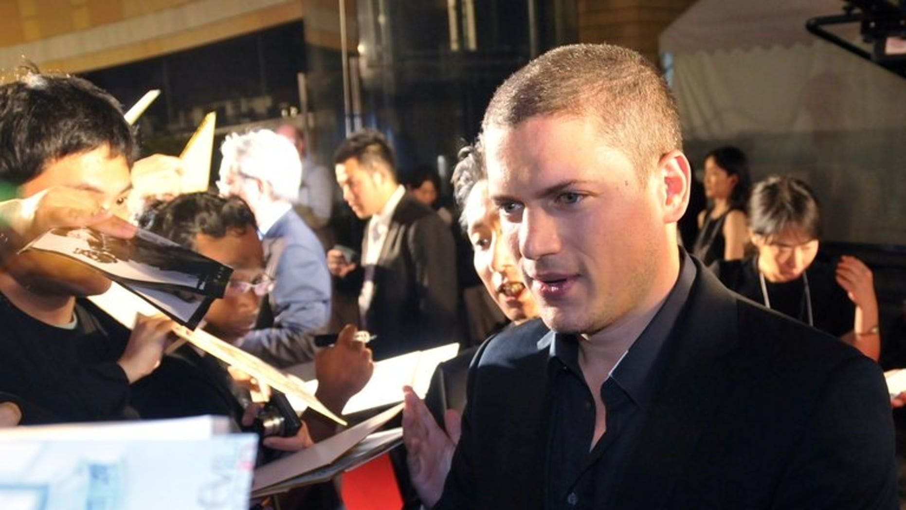 """Actor Wentworth Miller signs autographs for with Japanese fans in Tokyo on September 2, 2010. Miller has come out as gay in an open letter to Russia in which he rejected an invitation to attend a film festival in protest at the Kremlin's ban on homosexual """"propaganda""""."""