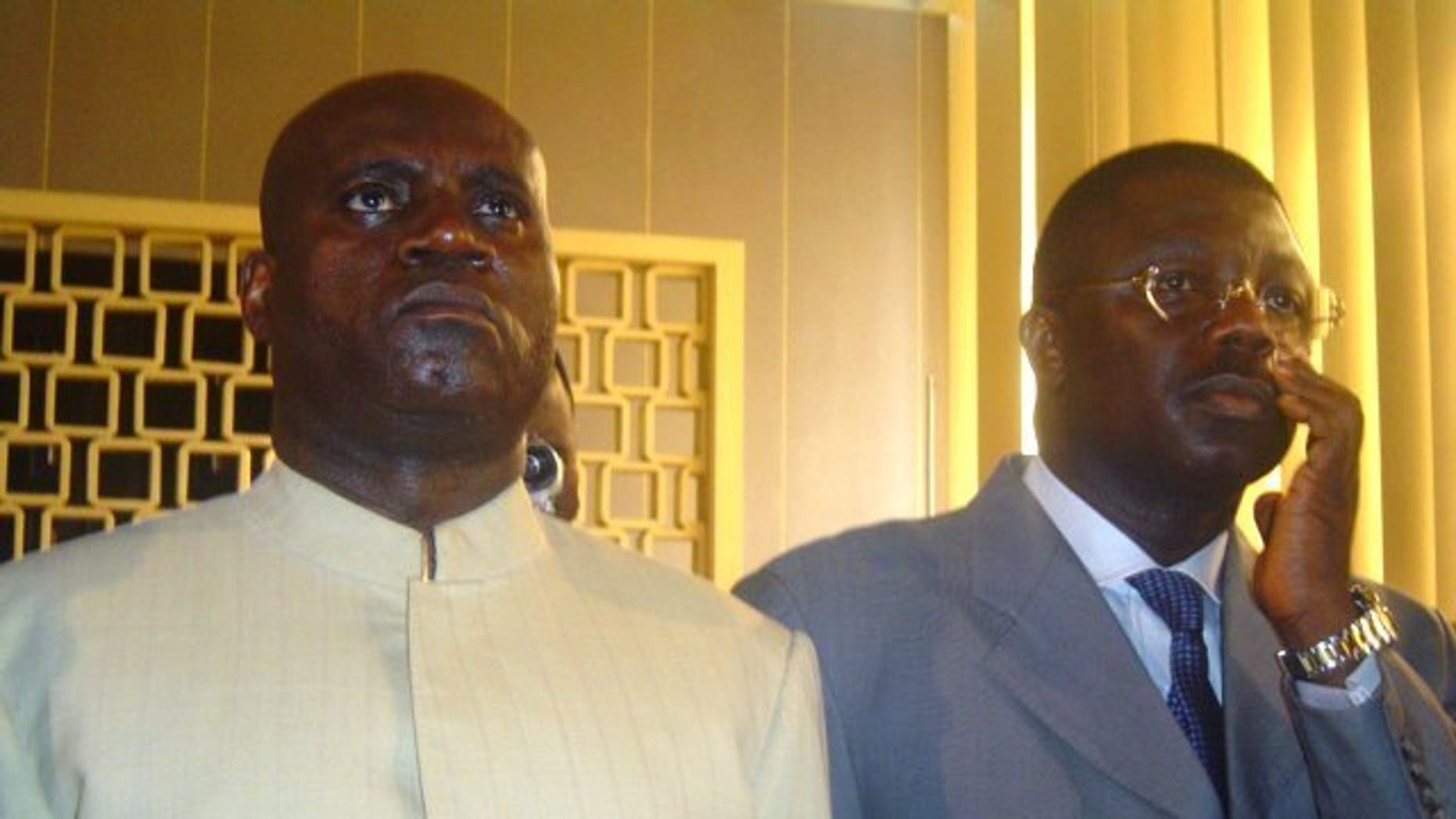 Norbert Dabira (L) listens to the verdict of a case on August 17, 2005 in Brazzaville. The Congolese general, wanted in connection with the 1999 disappearance of 350 refugees, was arrested in France on Thursday and charged with crimes against humanity, a court source said.