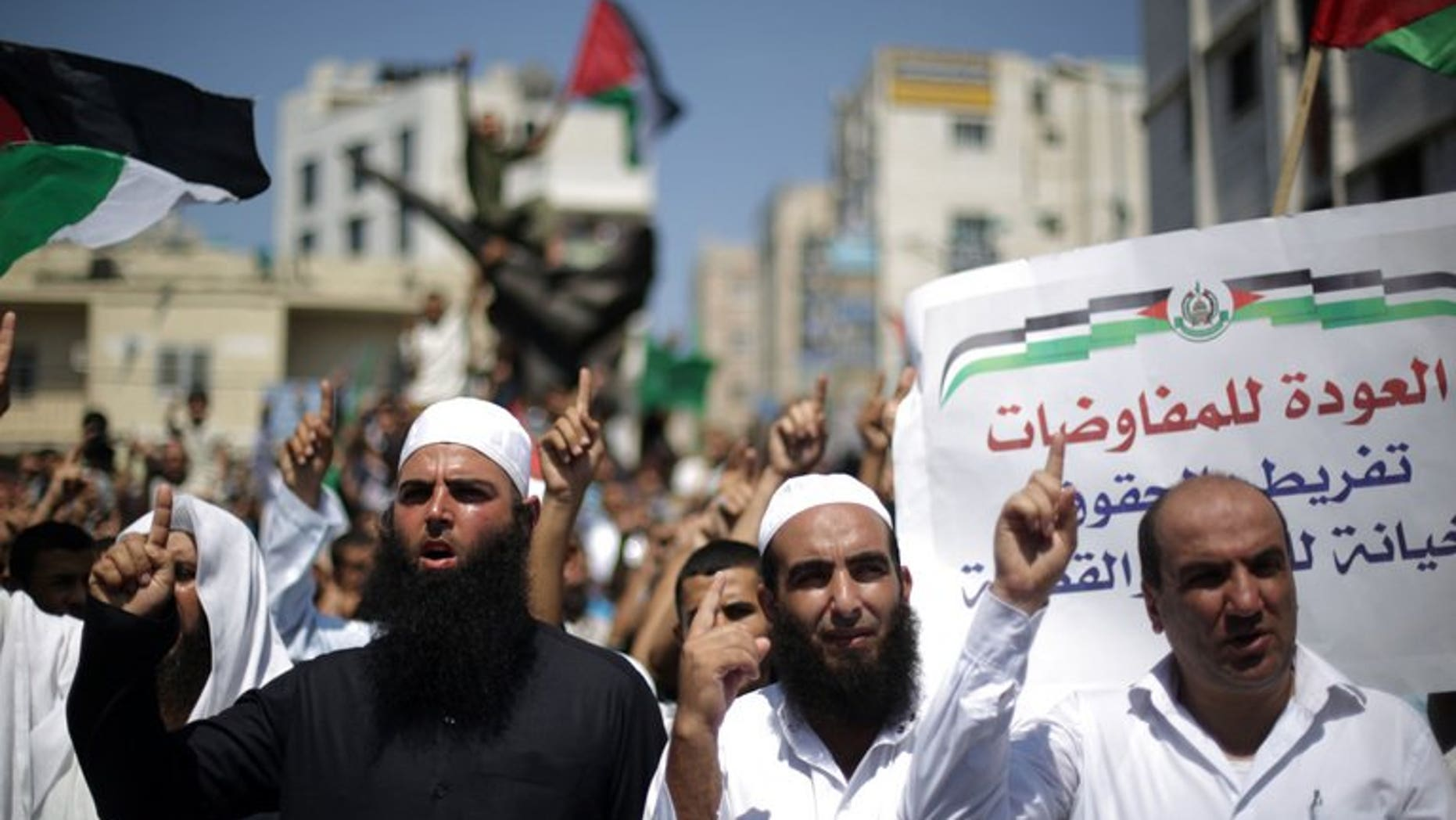 Palestinian supporters of Hamas and protest against Palestinian-Israeli negotiations on August 23, 2013, in Gaza City. Hundreds of people in the Gaza Strip protested on Friday against Israeli-Palestinian peace talks, in marches organised by Hamas and Islamic Jihad.