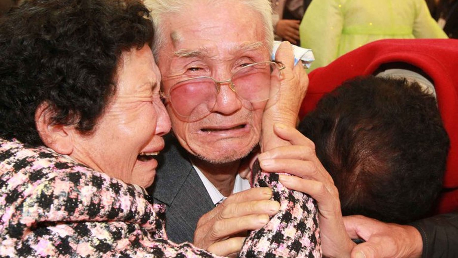 North Korean Kim Jin-Won (centre) cries with his South Korean relatives as they bid farewell following their three-day separated family reunion meeting at Mount Kumgang resort on the North's southeastern coast, near the border, on November 1, 2010. South and North Korea agreed Friday to go ahead with reunions next month for families separated for decades by the 1950-53 Korean War, Seoul said.