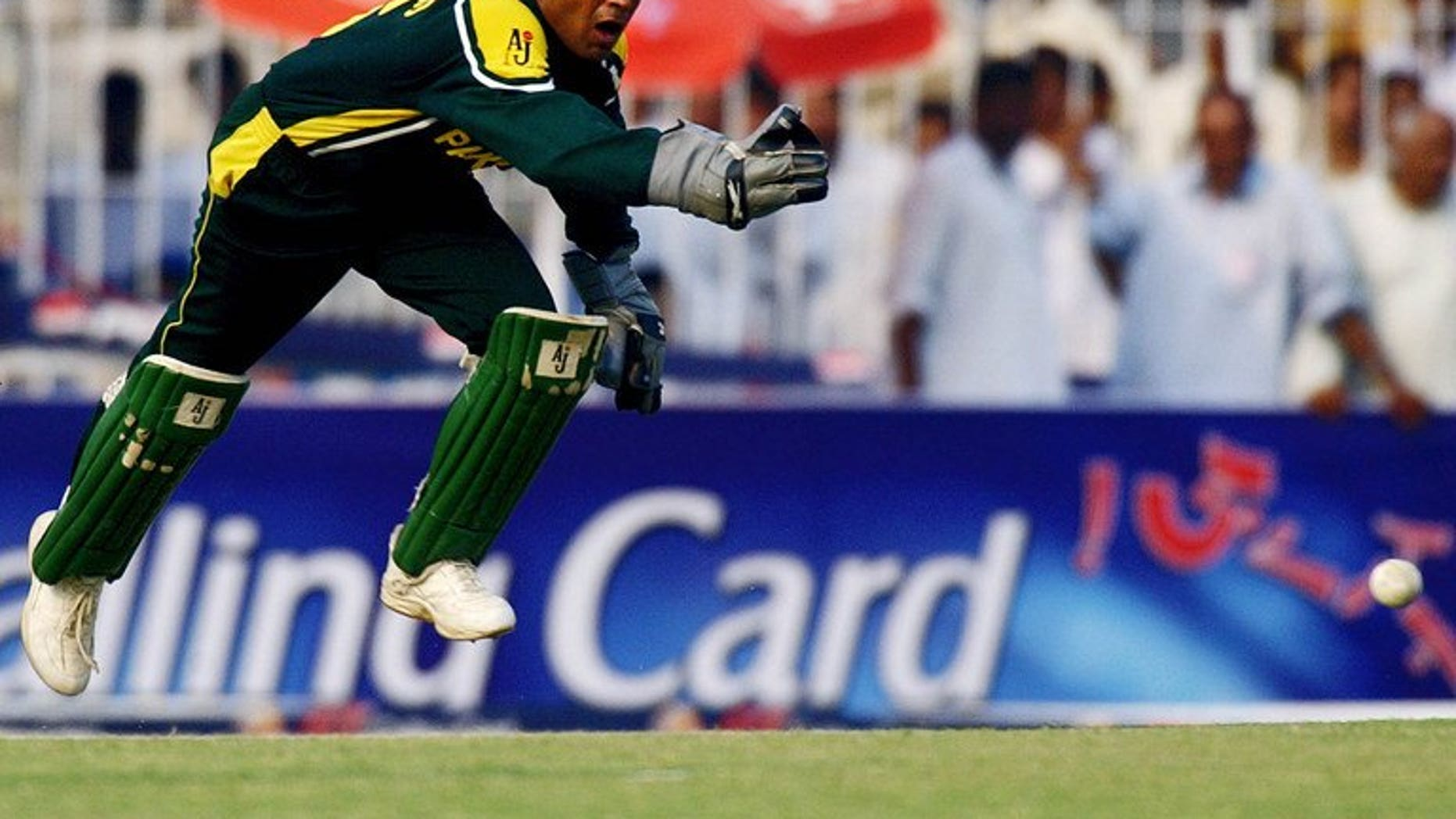 Pakistani wicketkeeper Rashid Latif leaps in an attempt to field a ball in Faisalabad, on October 7, 2003. The Pakistan Cricket Board said Friday that former captain Latif must apologise or provide proof supporting his claims that an alleged bookie was their guest in 2005.