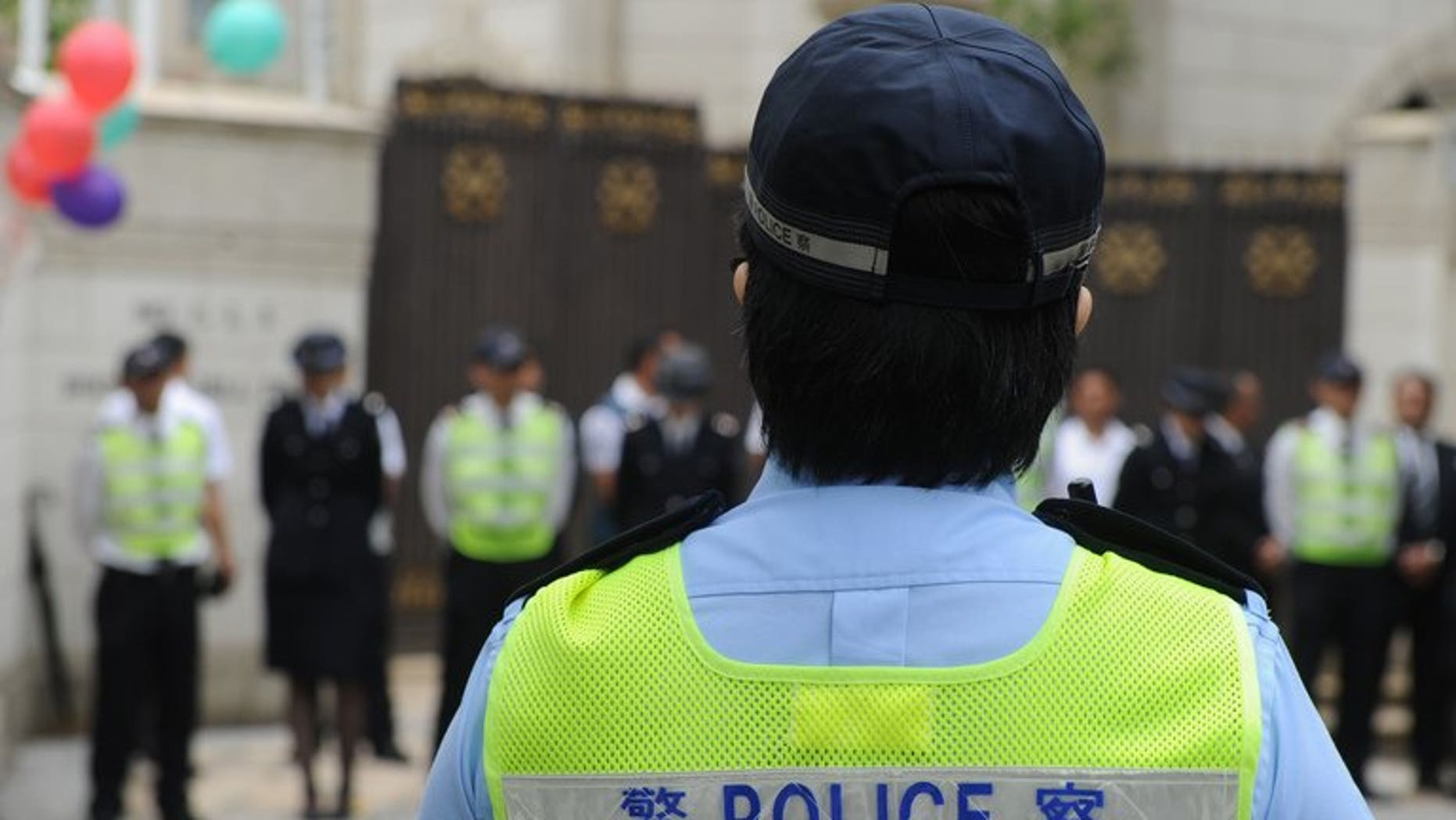 Police keep vigil in Hong Kong on April 21, 2013. Hong Kong police said Friday they had arrested more than 1,800 people during anti-triad raids for crimes including illegal gambling and drug offences.