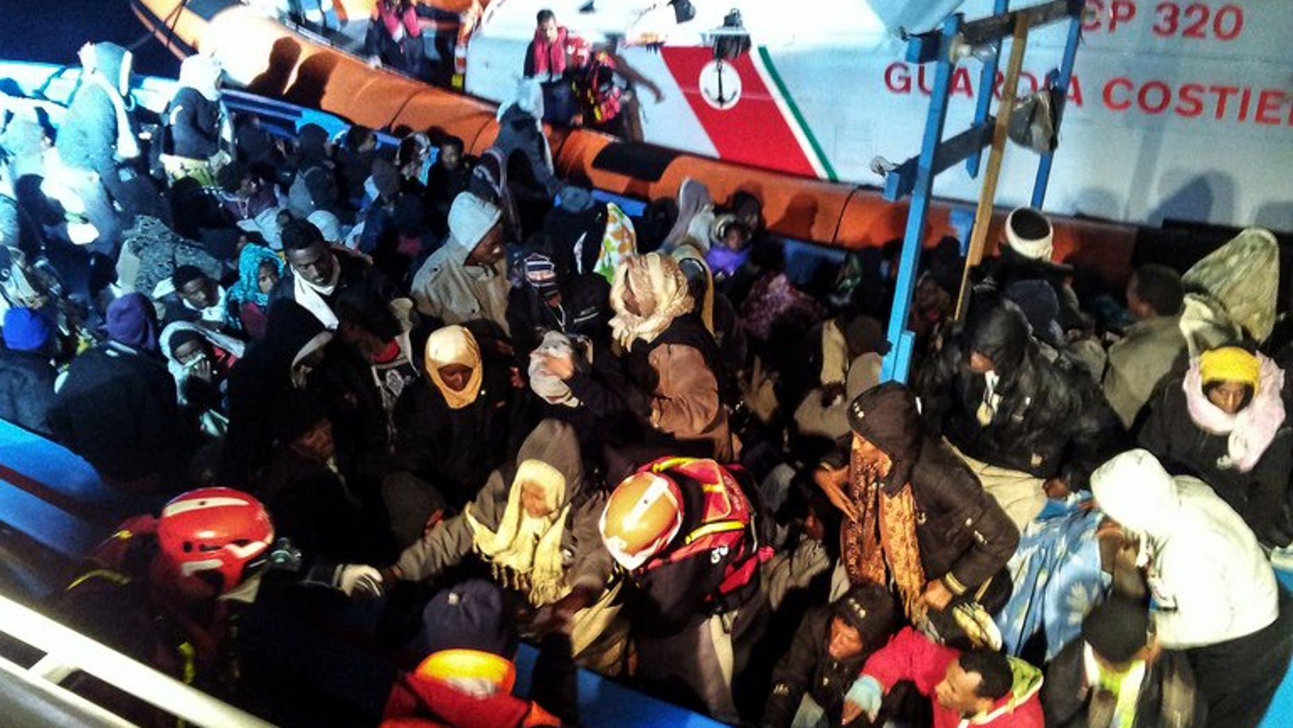 A handout photo provided on December 15, 2012 by the Italian Coast Guard press office shows a boat carrying 218 sub-Saharan migrants near the island of Lampedusa on December 14. The Italian coast guard said Saturday it had rescued more than 200 migrants off Sicily, swelling the ranks of the thousands of boat people who have made the crossing thanks to calm summer waters.