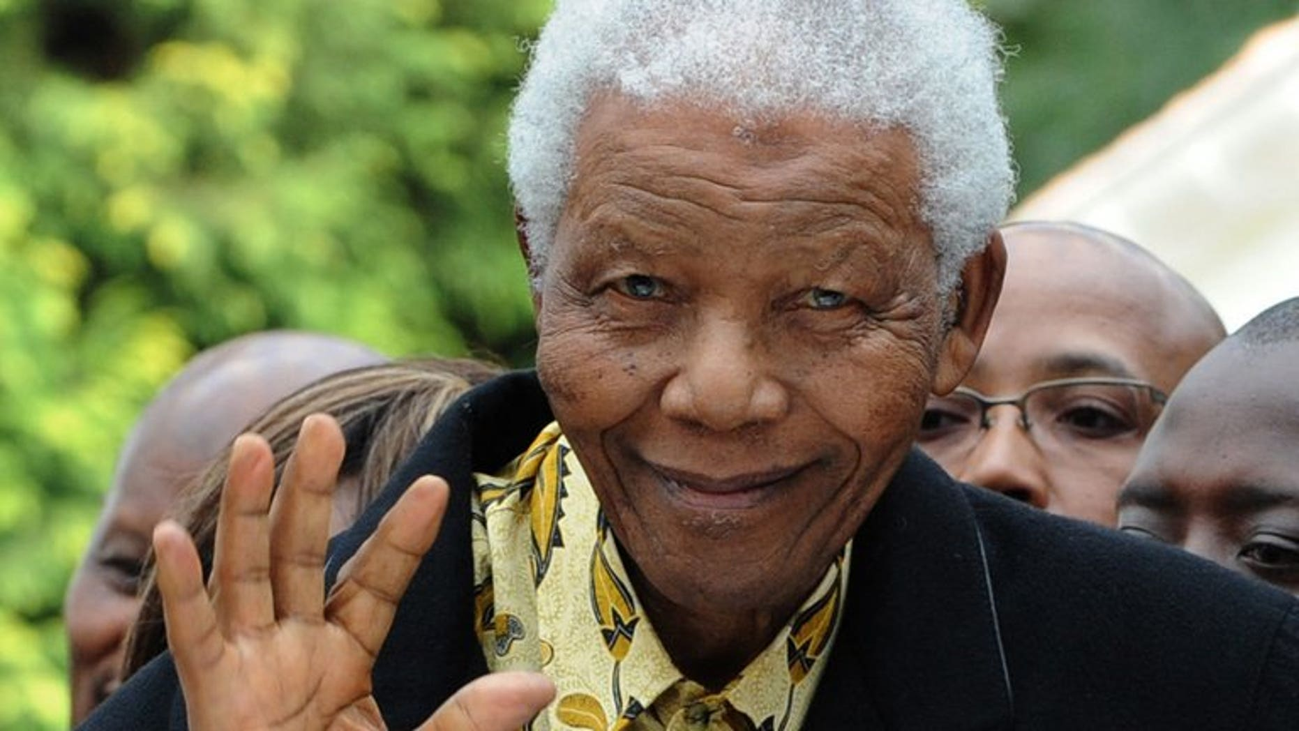"""South African former President Nelson Mandela waves as he arrives at a polling station in Johannesburg on April 22, 2009. Mandela is """"unstable"""" at times but has shown """"great resilience"""" as he remains in a critical condition in hospital, South Africa's presidency said Saturday."""