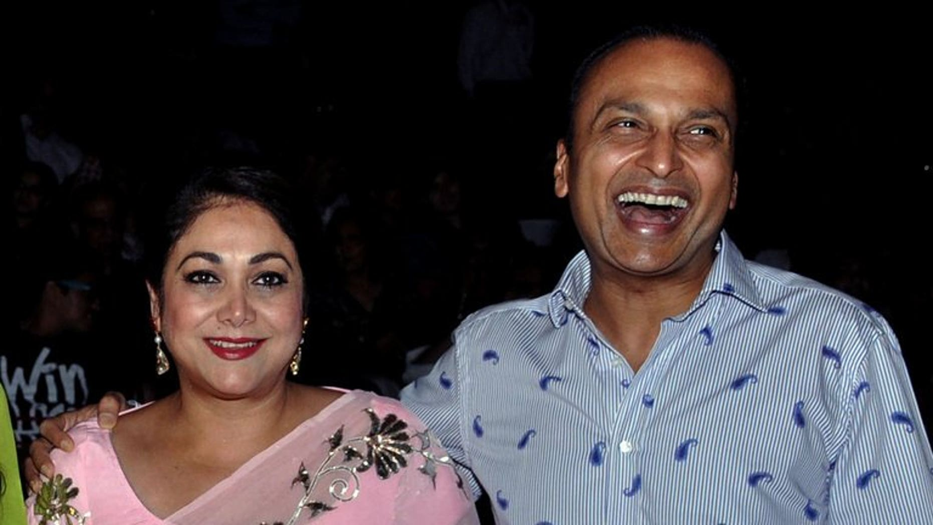 """Indian socialite Tina Ambani (L) and industrialist Anil Ambani, seen in Mumbai on October 18, 2012. The former Bollywood star has told a court hearing a massive corruption case that she had no knowledge of the companies allegedly involved as she is a """"housewife""""."""
