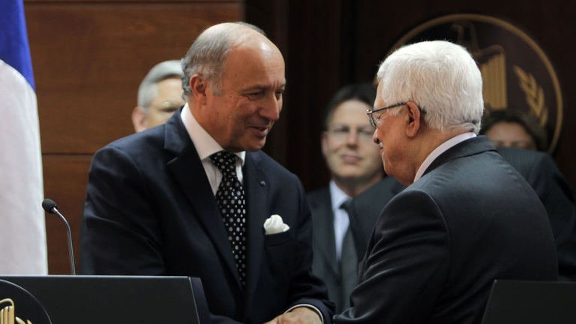 """French Foreign Minister Laurent Fabius meets Palestinian President Mahmoud Abbas (R) on August 24, 2013 in Ramallah, the West Bank. A succesful outcome to the Israel-Palestinians negotiations would be like a """"thunderbolt"""" for peace in the crisis-ridden Middle East, Fabius said."""