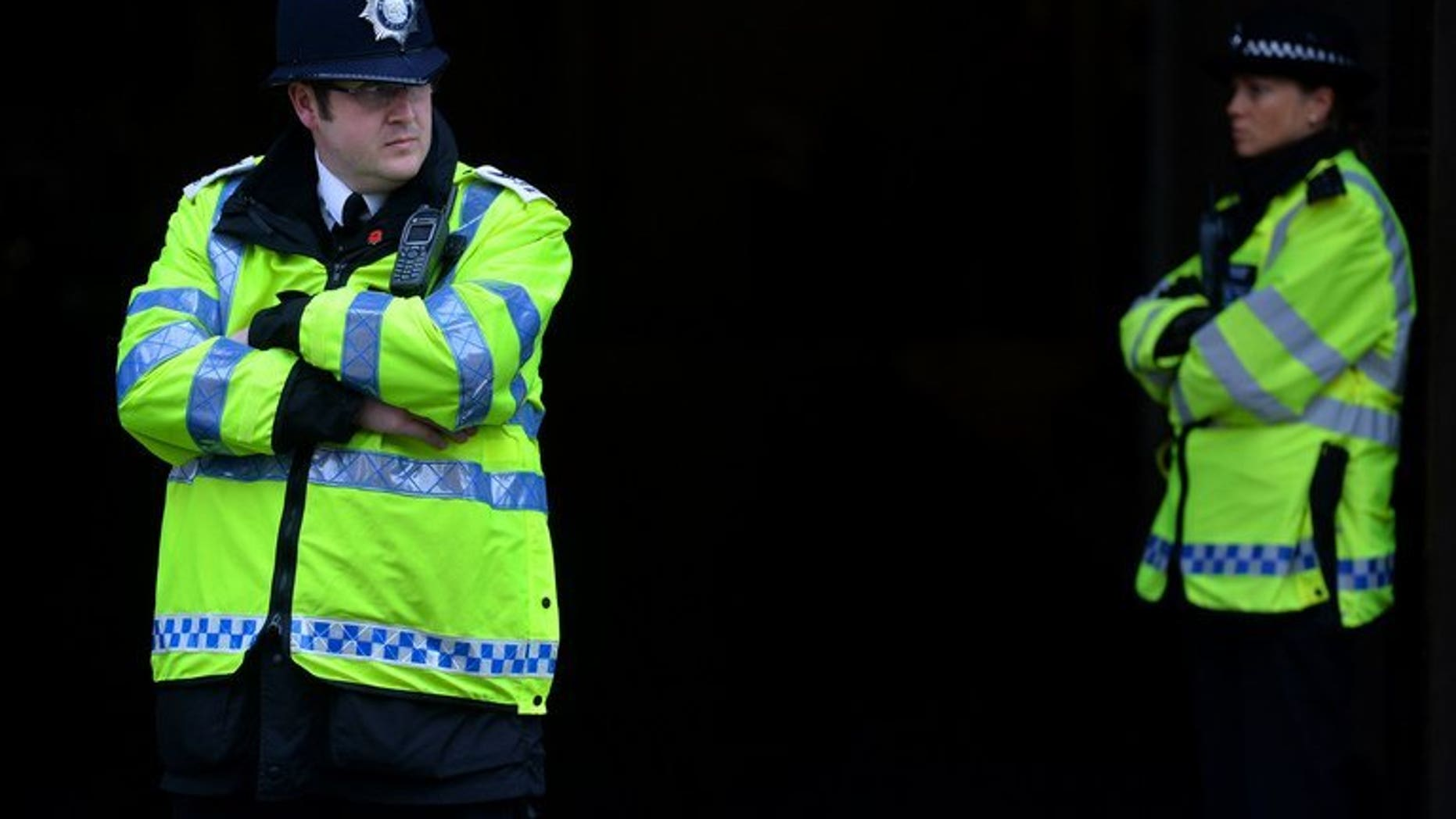 British police officers at Westminster Magistrates court in central London on May 30, 2013. A 24-year-old woman has died in hospital on Saturday after a double shooting while out celebrating her birthday in North London, police said.