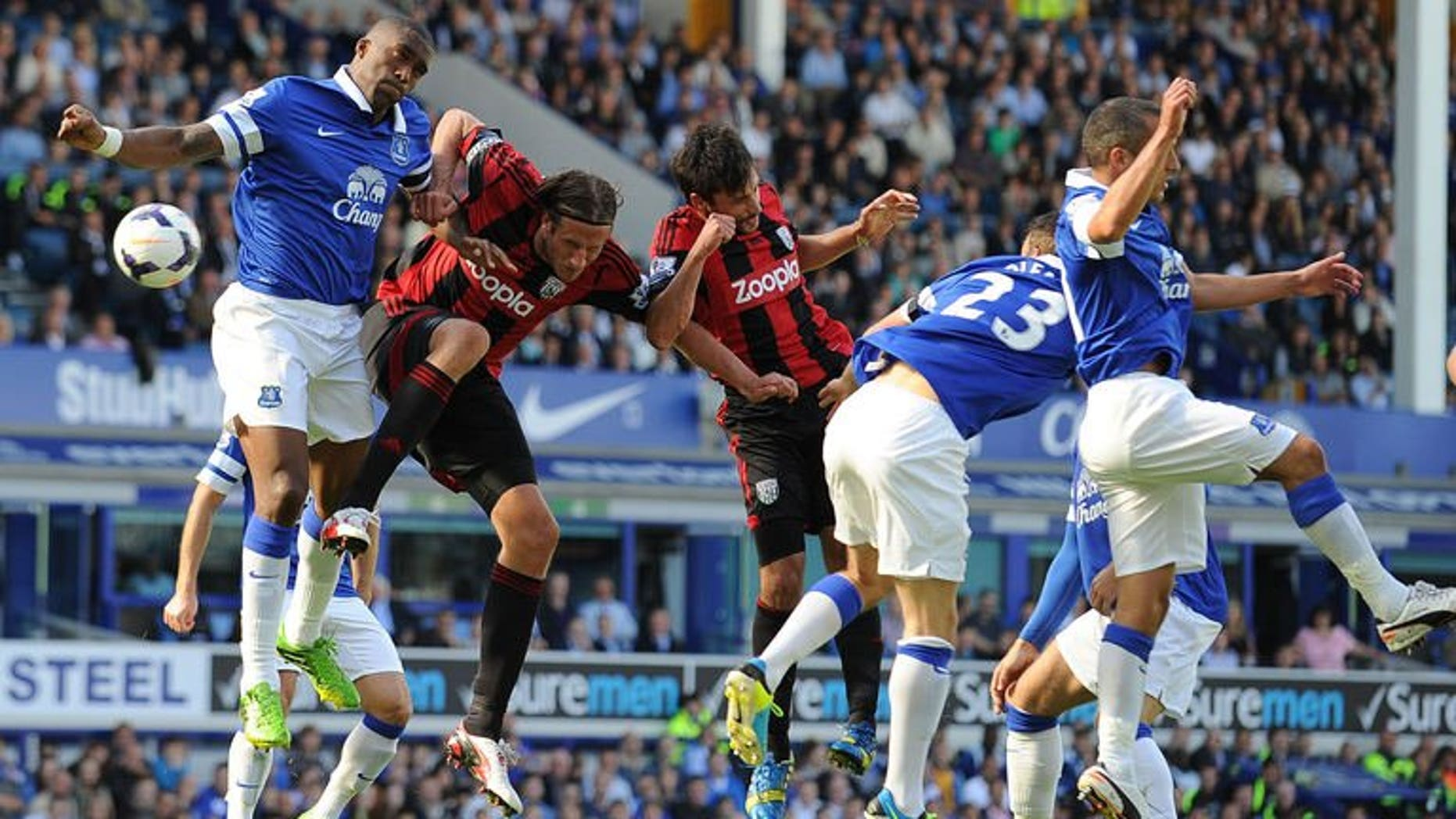 Everton's French defender Sylvain Distin (L) vies with West Bromwich Albion's Swedish defender Jonas Olsson (2nd L) during the English Premier League football match between Everton and West Bromwich Albion at Goodison Park in Liverpool on August 24, 2013. The game ended 0-0.