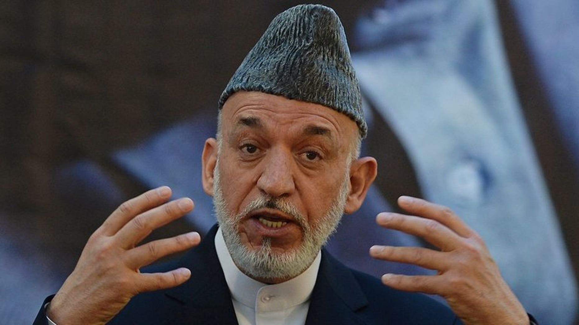 Afghan President Hamid Karzai speaks at a military academy outside Kabul on June 18, 2013. Karzai said Saturday that the United States should ensure a better future for villages where an American army sergeant went on a killing rampage last year.