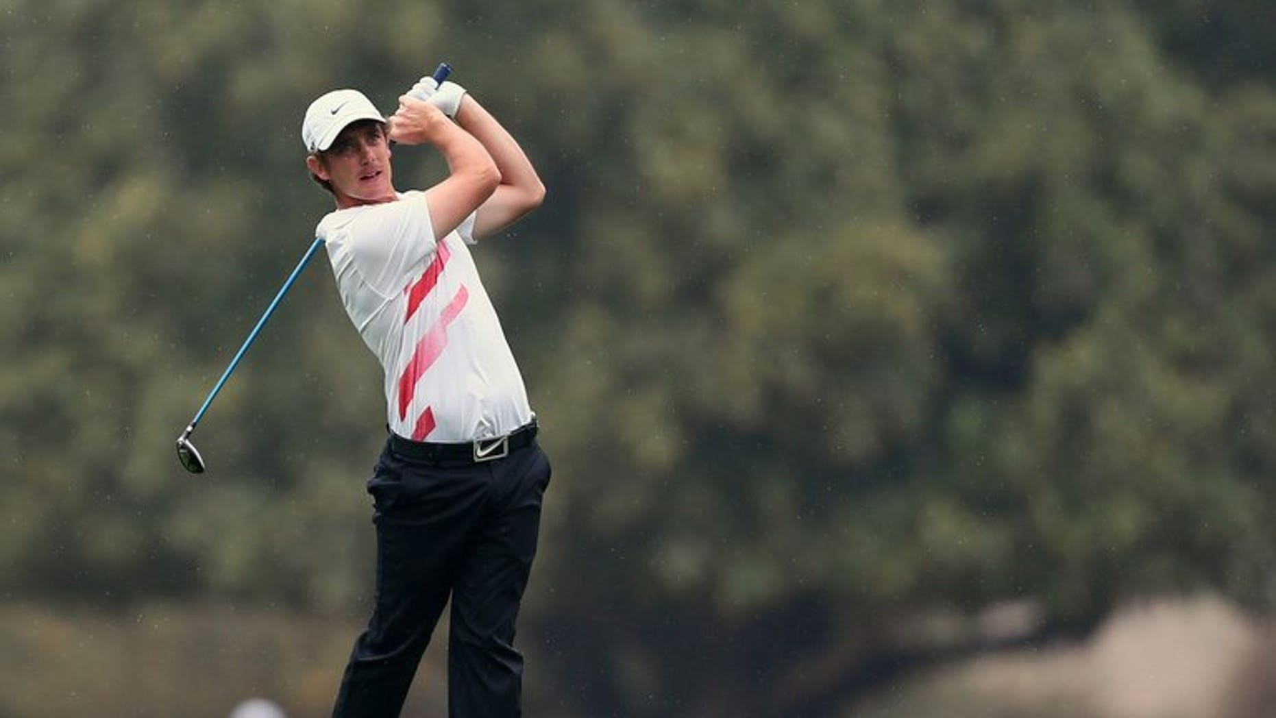 Tommy Fleetwood of Britain tees off during the third round of the Dubai Desert Classic golf tournament in Dubai on February 2, 2013. Fleetwood earned a share of the lead with Argentina's Ricardo Gonzalez after the third round of the Johnnie Walker Championship at Gleneagles on Saturday.