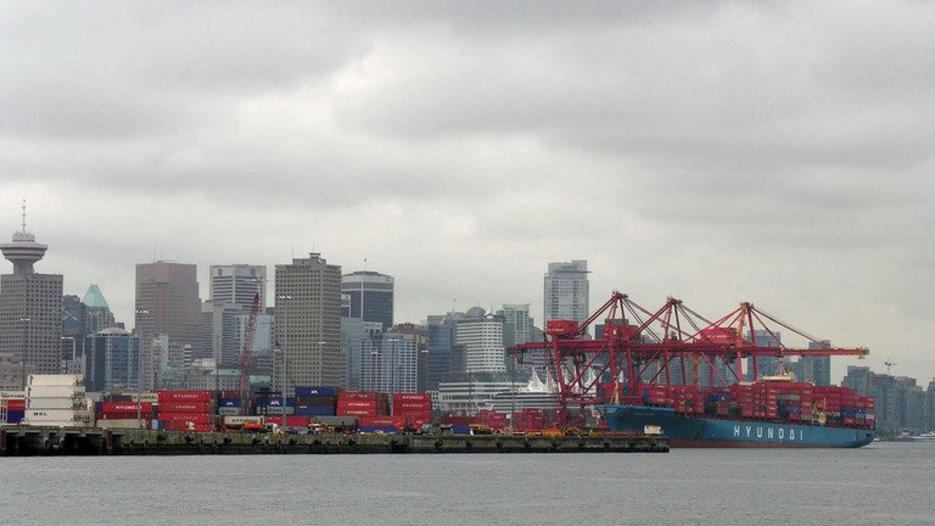 A container ship unloads in 2005 at the P&O Central Terminal in the Port of Vancouver. Canada's trade deficit doubled in July as imports increased and exports declined, the government statistical agency said Wednesday.