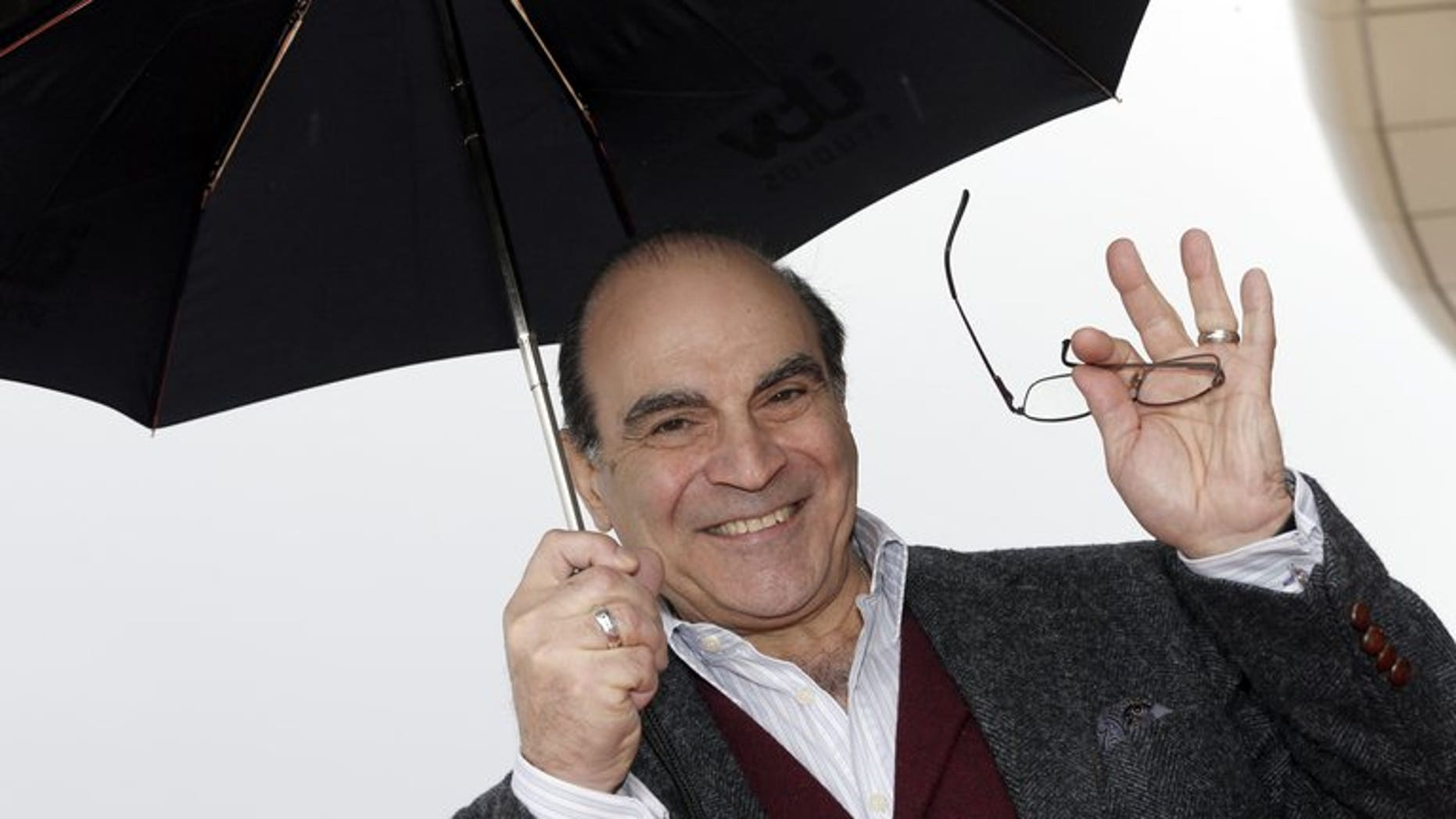 """British actor David Suchet poses during the photocall of """"Poirot"""" on April 8, 2013 in Cannes, southeastern France. Agatha Christie's mustachioed detective Hercule Poirot is to be resurrected in a new novel nearly 40 years after his last adventures."""