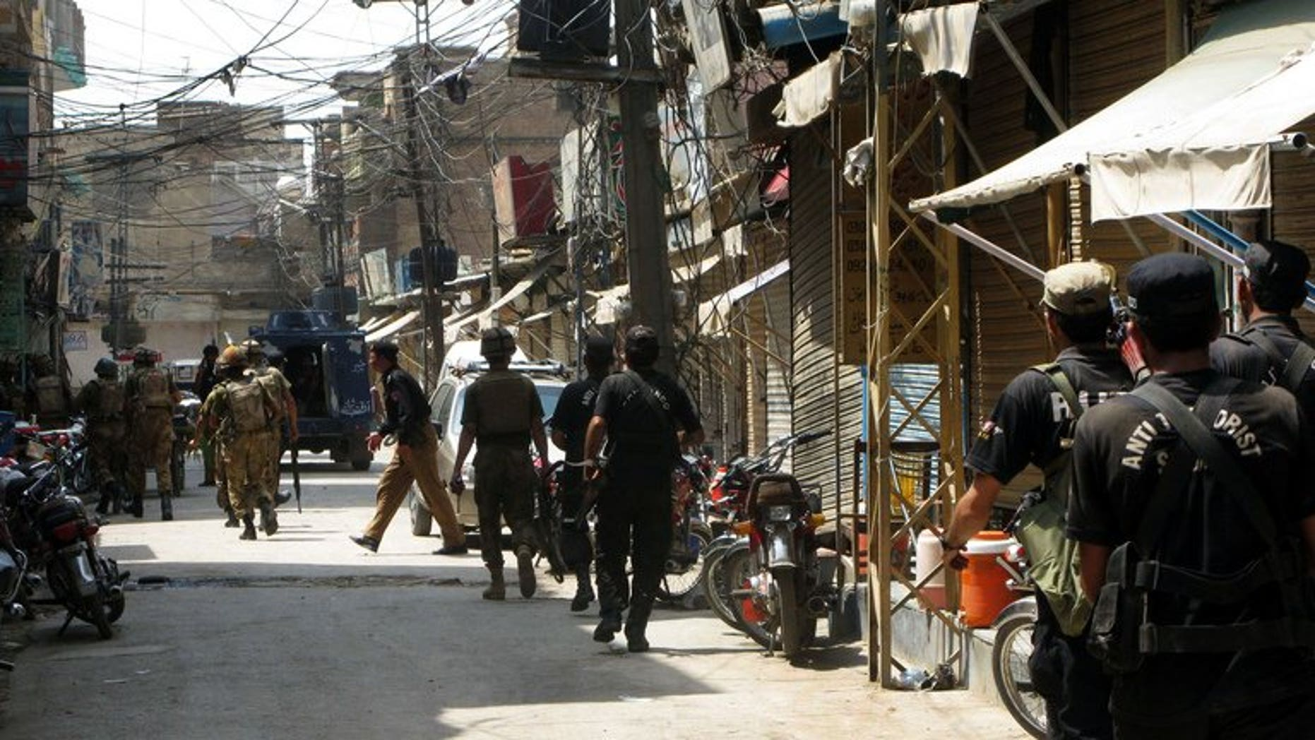 Pakistani soldiers patrols the streets of Bannu, on July 16, 2012. A bomb has wounded 11 people, mostly children, when it exploded outside a Pakistani girls' school in Bannu, a doctor has told AFP.
