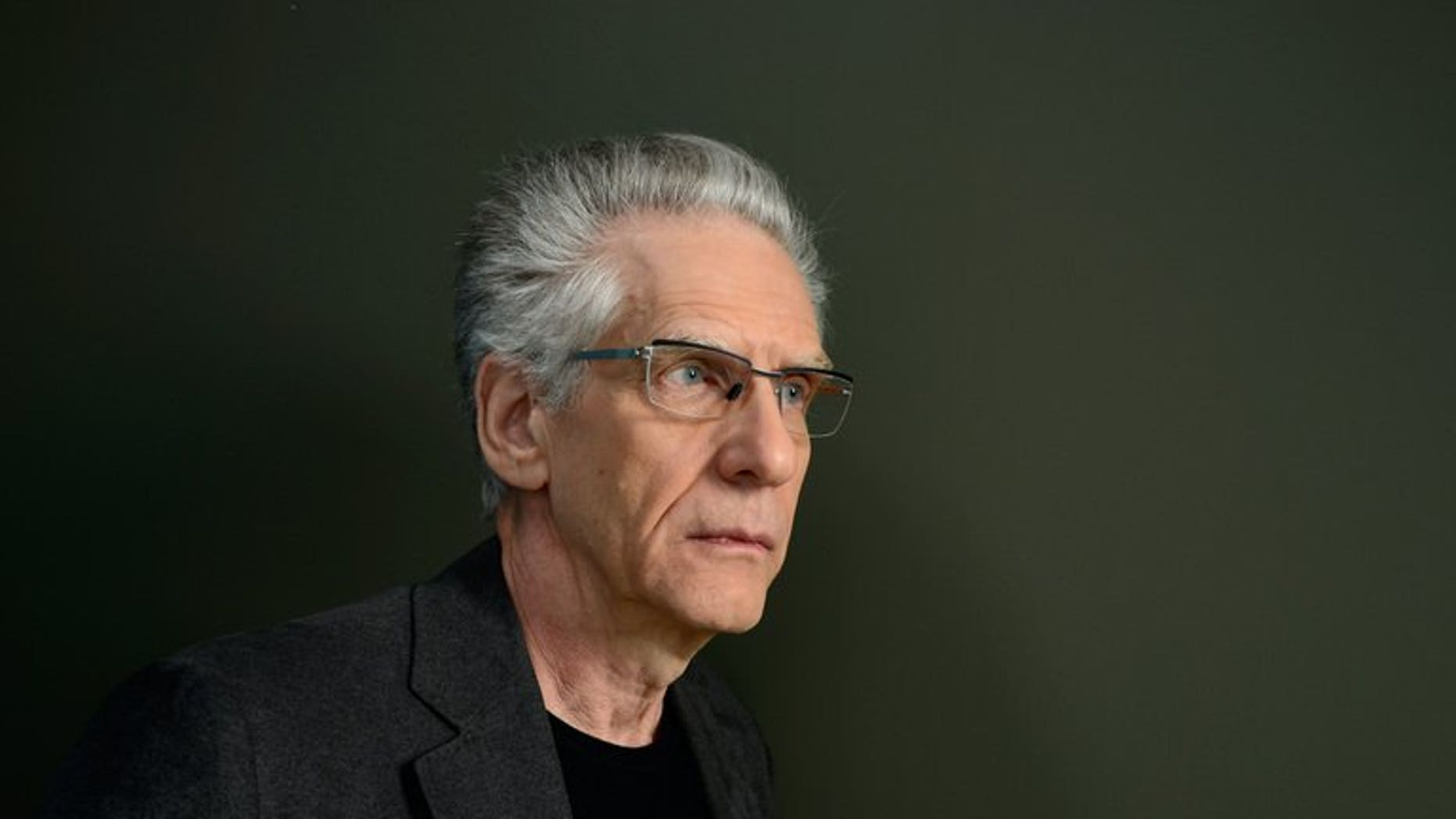 """Director David Cronenberg poses at the Guess Portrait Studio during the 2013 Toronto International Film Festival on September 5, 2013 in Toronto, Canada. Life, not his films, is """"weird and strange,"""" Cronenberg said as the Toronto film festival announced a retrospective of his cold, clinical, and often gory movies."""