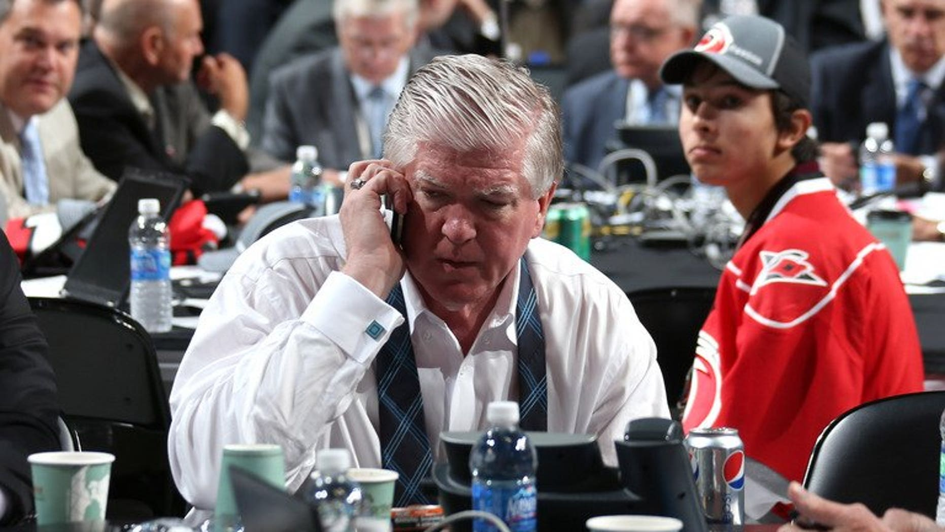 Then Toronto Maple Leafs General Manager Brian Burke, pictured at Consol Energy Center in Pittsburgh, Pennsylvania, on June 23, 2012. Burke, who helped assemble the 2007 Anaheim Ducks' Stanley Cup winning team, has been hired as the president of hockey operations for the Calgary Flames, according to the team.
