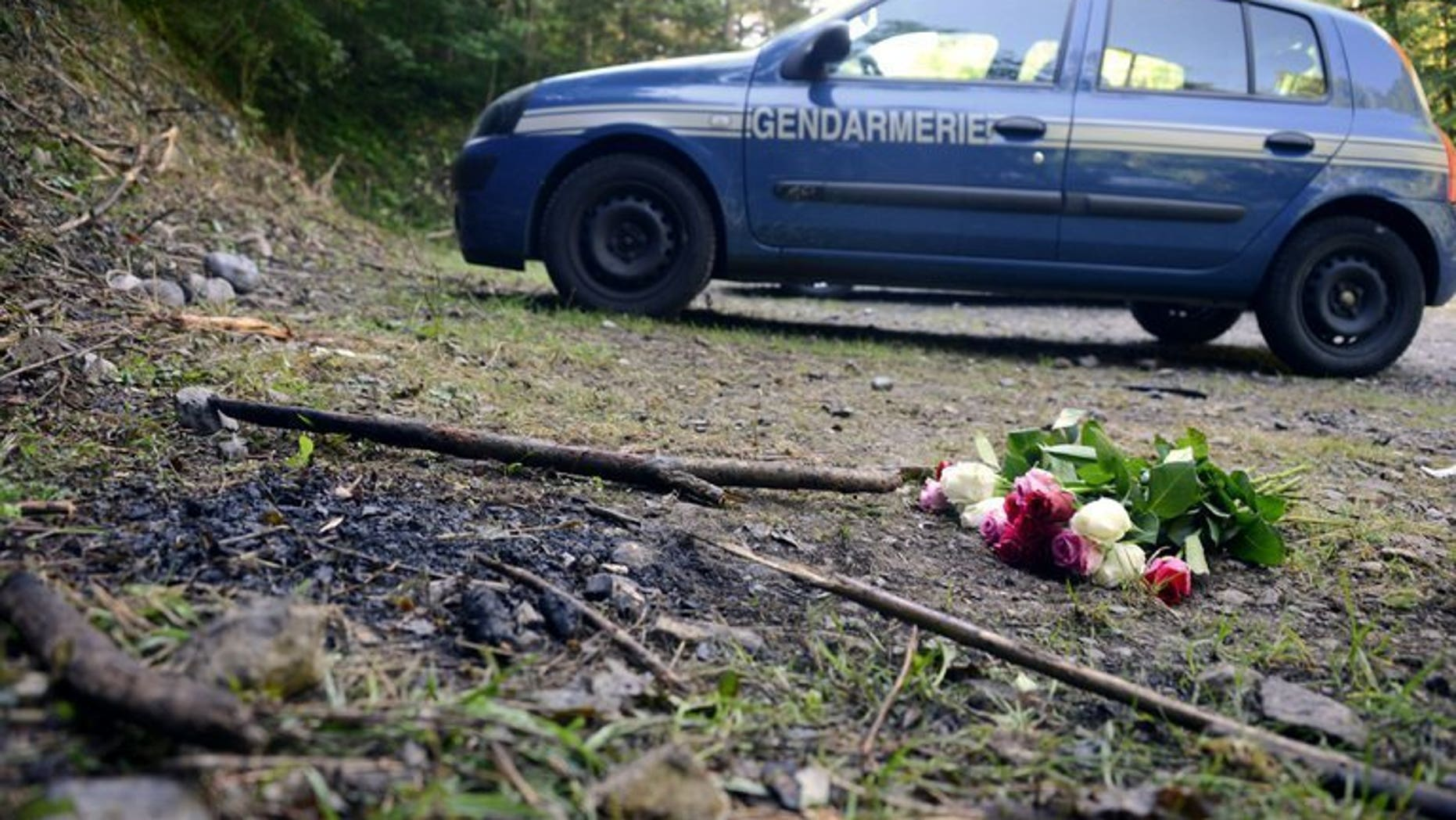 A French gendarmerie car is parked on September 8, 2012, at the place where three members of a British-Iraqi family and a local man were shot dead in the French Alpine village of Chevaline. French and British investigators say they have made significant progress in the brutal quadruple murder.