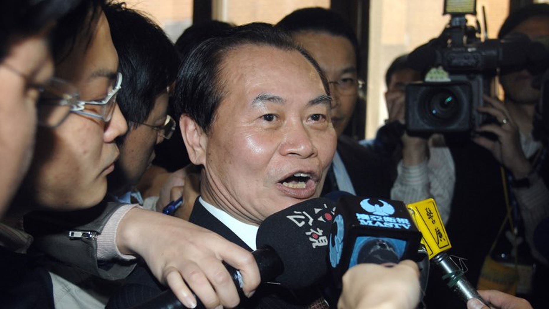Taiwan minister Tseng Yung-fu (centre) speaks to reporters in Taipei, on March 22, 2010. Tseng has resigned after he was accused of meddling in a lawmaker's court case in the latest judicial scandal to hit the island.