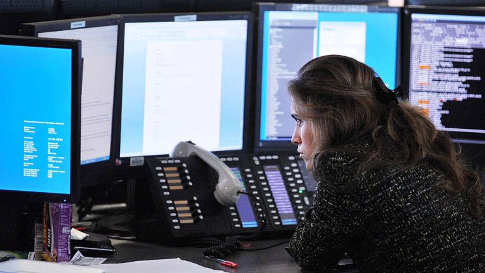 A broker monitors market movements at BGC Partners in London, on August 5, 2011. London shares closed lower as sentiment was hit by fresh fears over Syria and the possible withdrawal of US Federal Reserve stimulus.