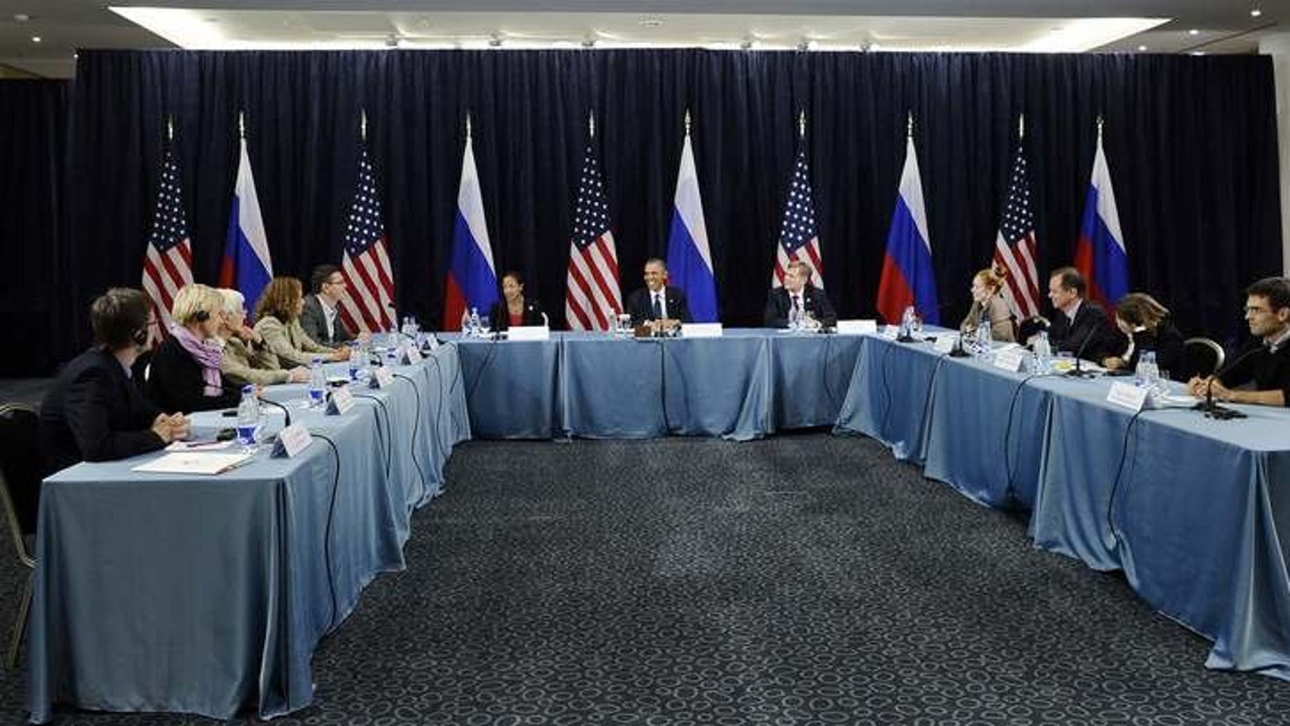 US President Barack Obama (C) holds a Civil Society Roundtable with gay, lesbian, transexual right activists at the Crowne Plaza Hotel in Saint Petersburg on September 6, 2013.