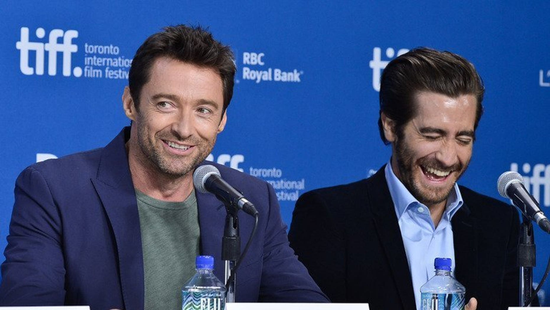 """Actors Hugh Jackman (L) and Jake Gyllenhaal speak onstage at the """"Prisoners"""" press conference during the 2013 Toronto International Film Festival on September 6, 2013 in Toronto, Canada. In Jackman's family, they stood on the couch and cheered for the accountants who tallied the Oscar ballots as they appeared on stage, he revealed Saturday."""